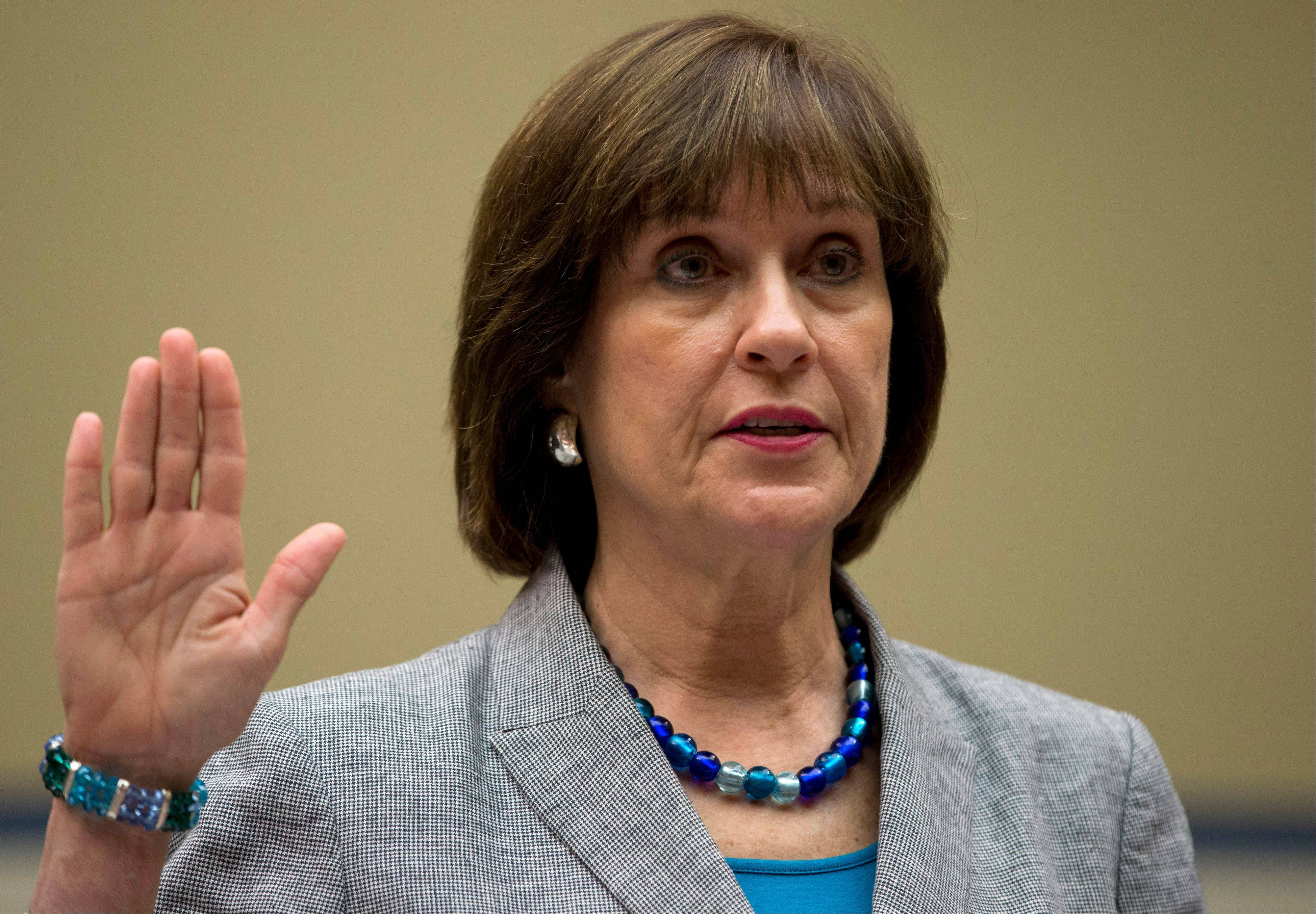 In this May 22, 2013, file photo, IRS official Lois Lerner is sworn in on Capitol Hill in Washington. Lerner headed the IRS division that handles applications for tax-exempt status when she was placed on paid leave in May. While she was in charge, the agency acknowledged that agents improperly targeted Tea Party groups for extra scrutiny when they applied for tax-exempt status from 2010 to 2012.