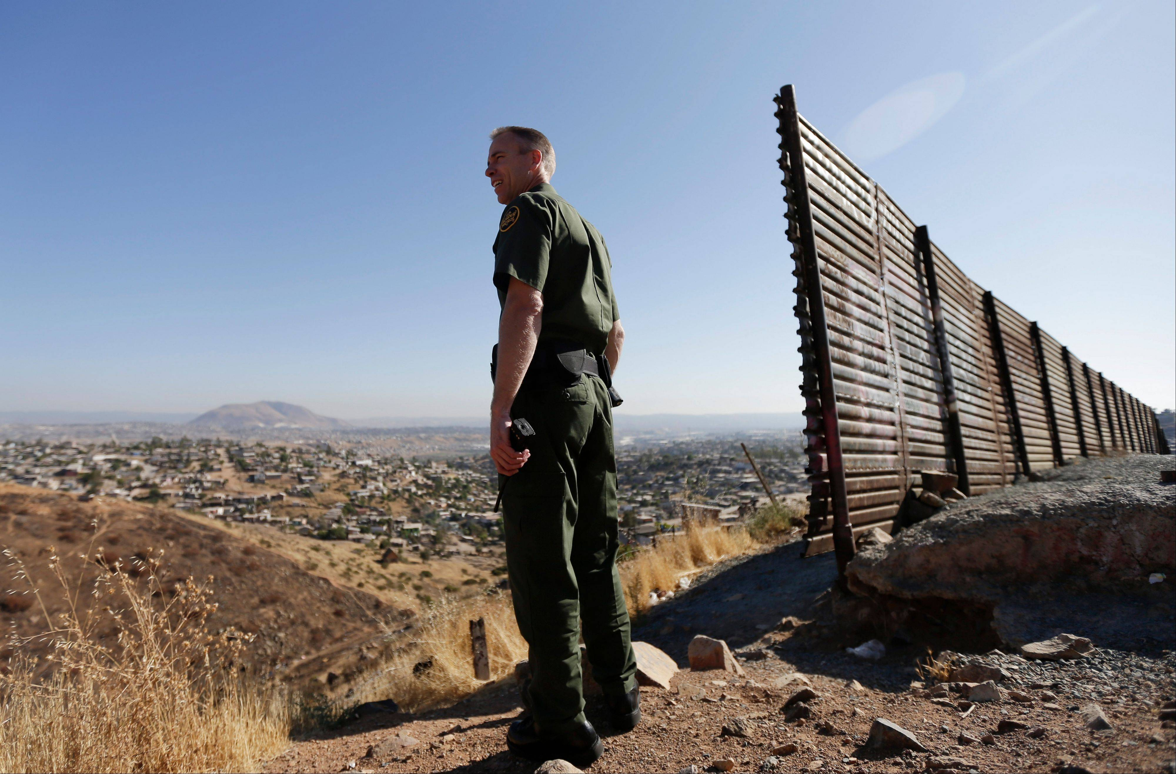 Associated Press In this June 13, 2013 file photo, US Border Patrol agent Jerry Conlin looks out over Tijuana, Mexico, behind, along the old border wall along the US - Mexico border, where it ends at the base of a hill in San Diego. After dropping during the recession, the number of immigrants crossing the border illegally into the U.S. appears to be on the rise again, according to a report released Monday, Sept. 23, 2013 by Pew Research Center's Hispanic Trends Project.