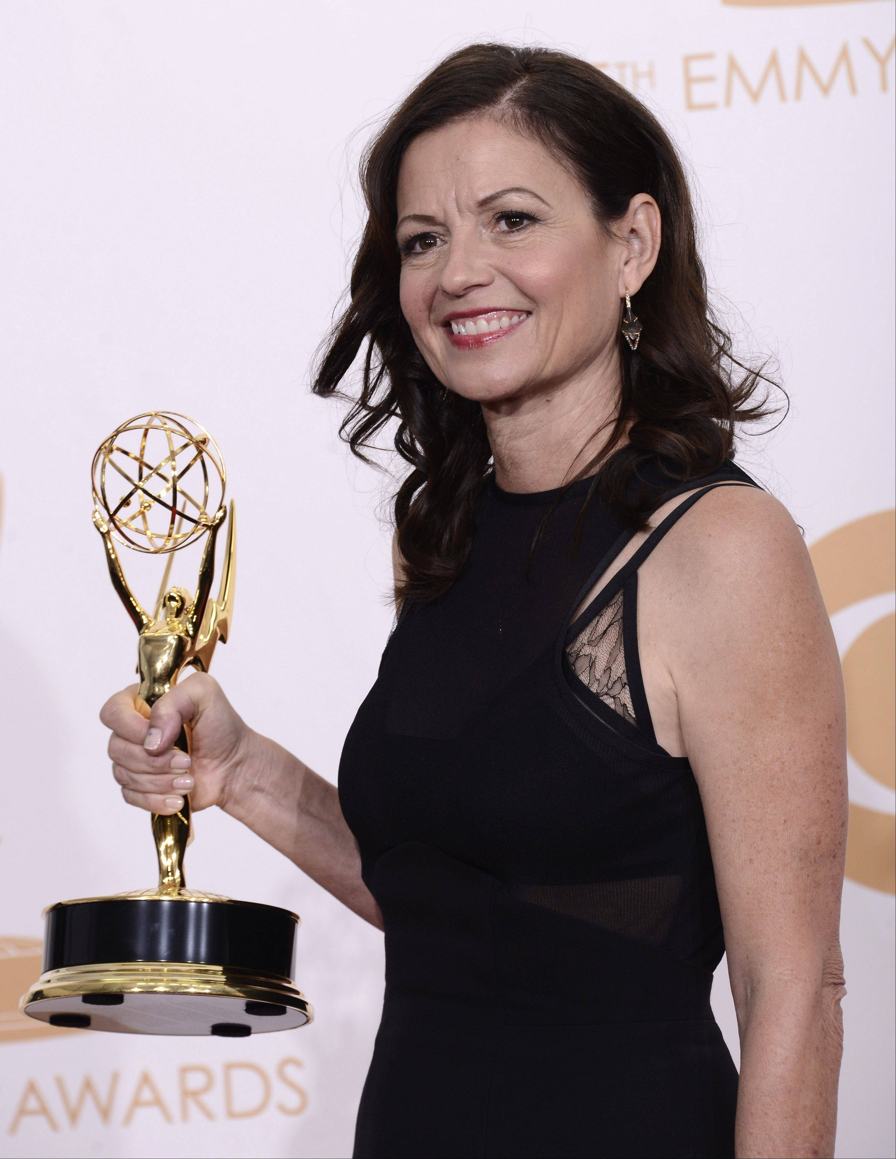 Director Gail Mancuso, a Melrose Park native, holds her Emmy for best directing for a comedy series for 'Modern Family' backstage at the 65th Primetime Emmy Awards at Nokia Theatre on Sunday in Los Angeles.