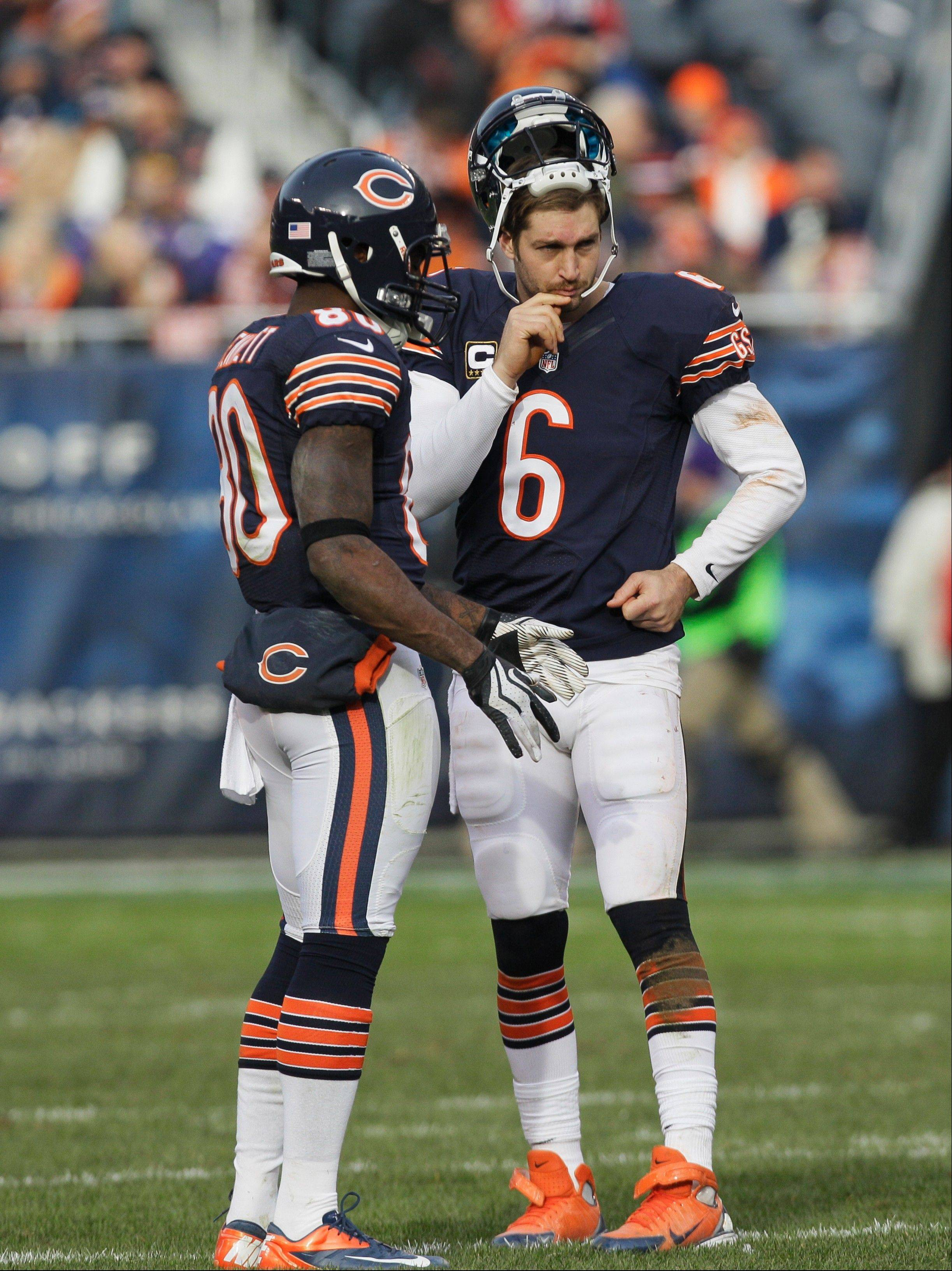 Bears quarterback Jay Cutler talks with wide receiver Earl Bennett during a break in the action last season against the Minnesota Vikings.