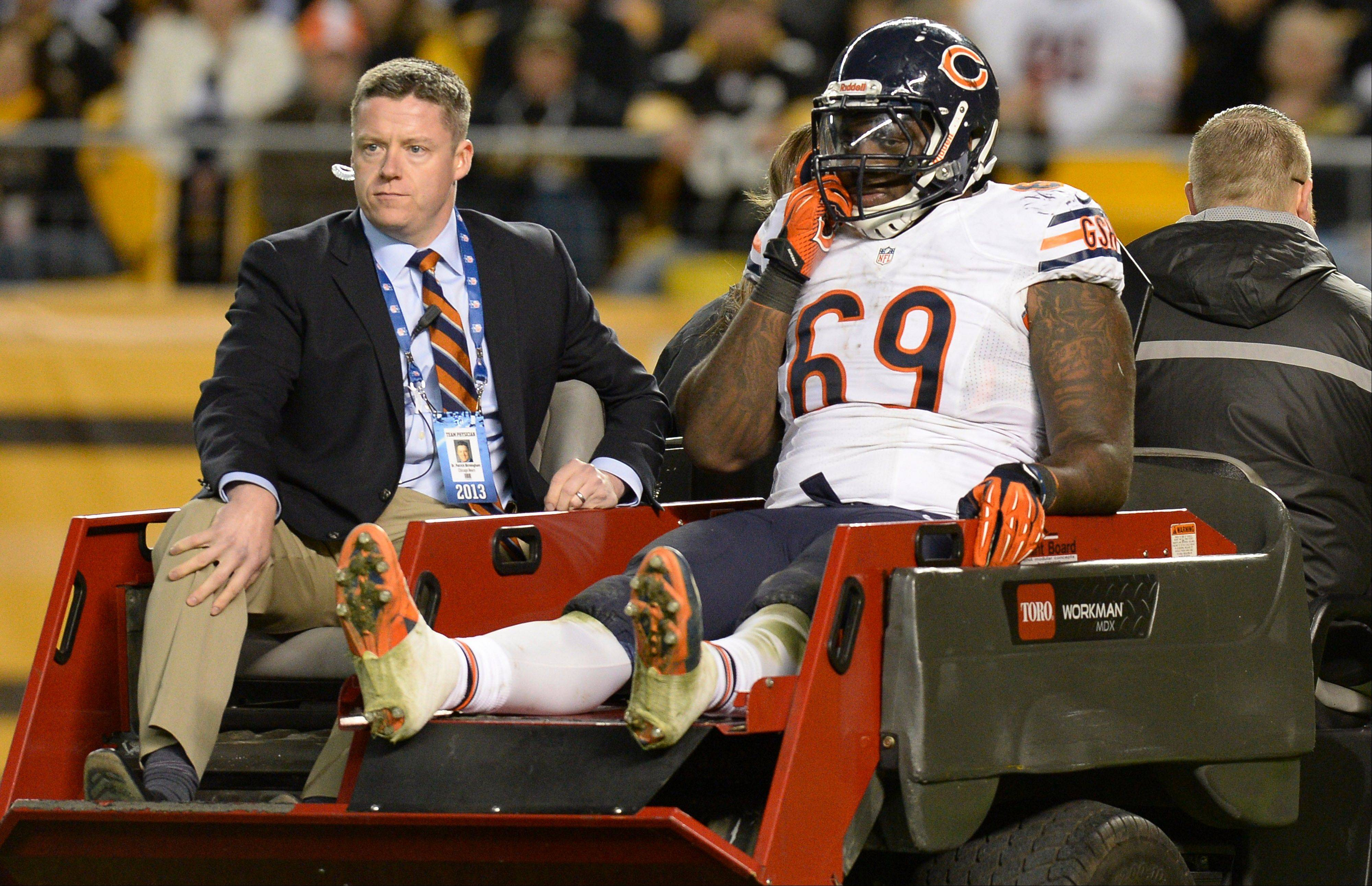 Chicago Bears defensive tackle Henry Melton (69) is carted off after being injured in the third quarter of an NFL football game against the Pittsburgh Steelers on Sunday, Sept. 22, 2013, in Pittsburgh. (AP Photo/Don Wright)