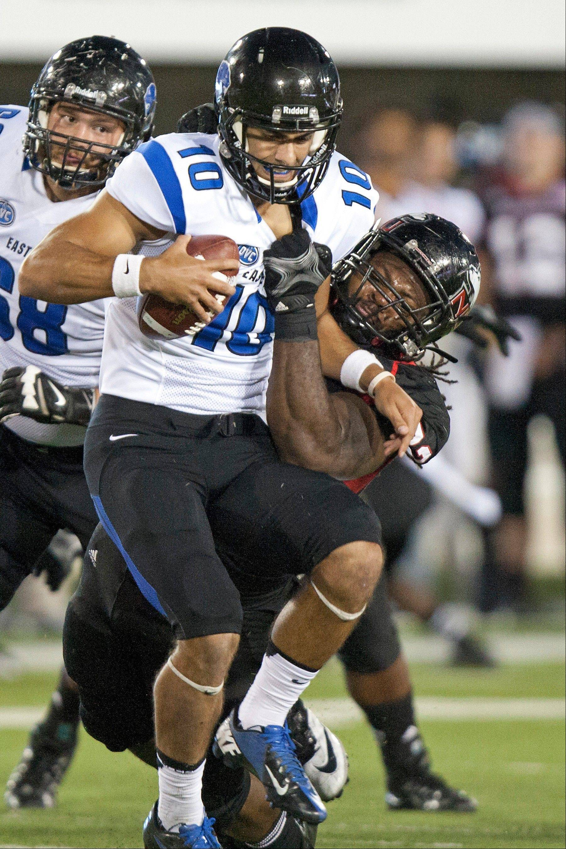 Ken Bishop of Northern Illinois brings down Eastern Illinois quarterback Jimmy Garoppolo in their high-scoring game Saturday. Garoppolo got EIU off to a 20-0 start but NIU came back to win and run its unbeaten streak at Huskie Stadium to 22-0.