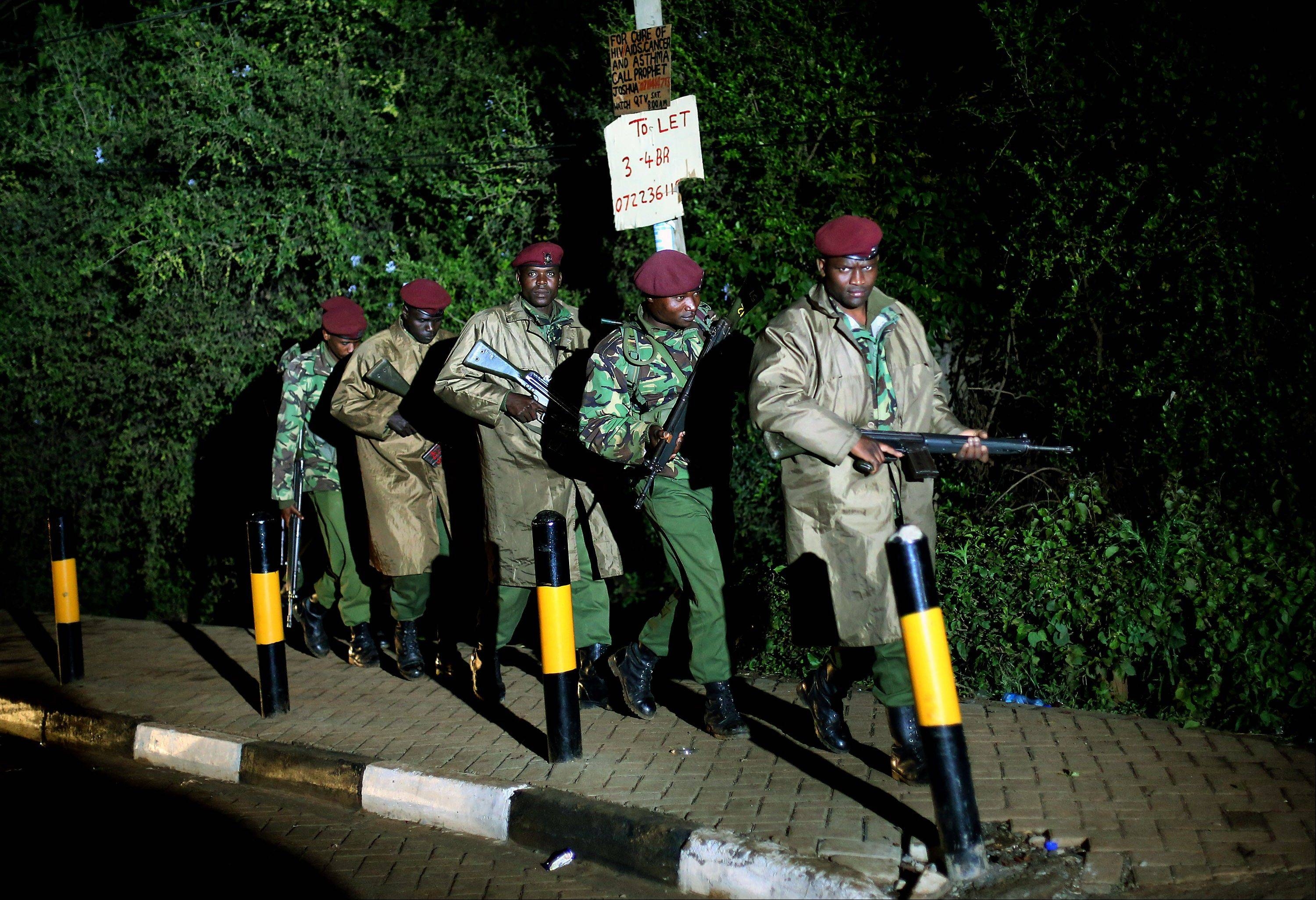 Kenyan Defense Forces leave the near vicinity of the Westgate Mall in Nairobi Kenya Monday Sept. 23 2013. Multiple large blasts have rocked the mall where a hostage siege is in its third day. Associated Press reporters on the scene heard multiple blasts and a barrage of gunfire. Security forces have been attempting to rescue an unknown number of hostages inside the mall held by al-Qaida-linked terrorists.