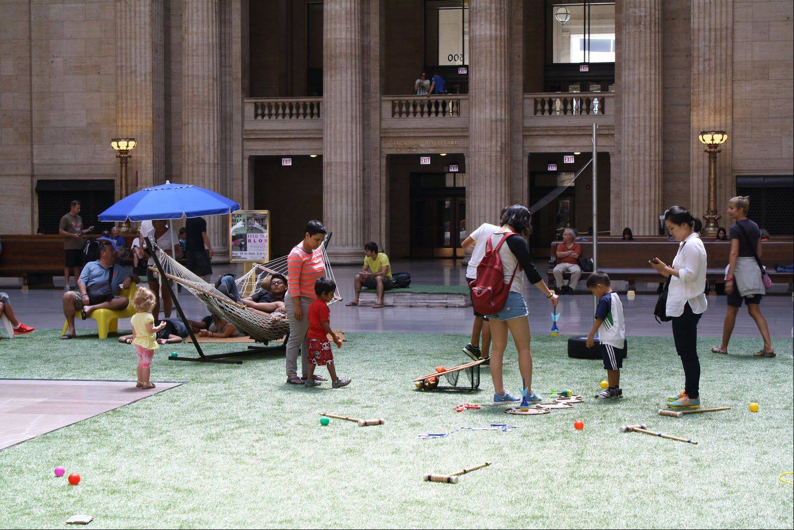 People use the play area in the Great Hall of Union Station that was a winning design of Buffalo Grove native Corey Nissenberg in a Chicago competition.
