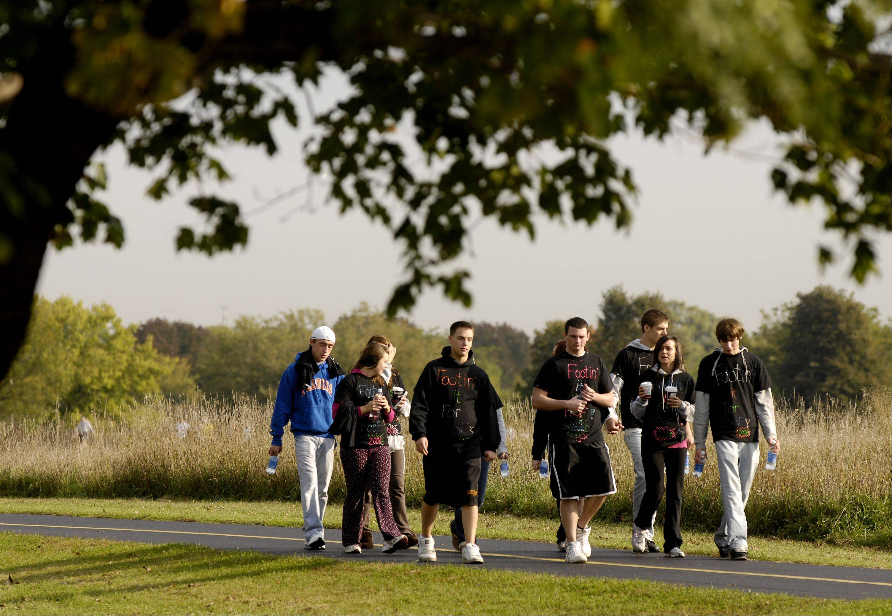 Family, friends and co-workers often form fundraising teams and participate together in the Ron Santo Walk to Cure Diabetes like this group taking part in the walk at Busse Woods in Schaumburg.