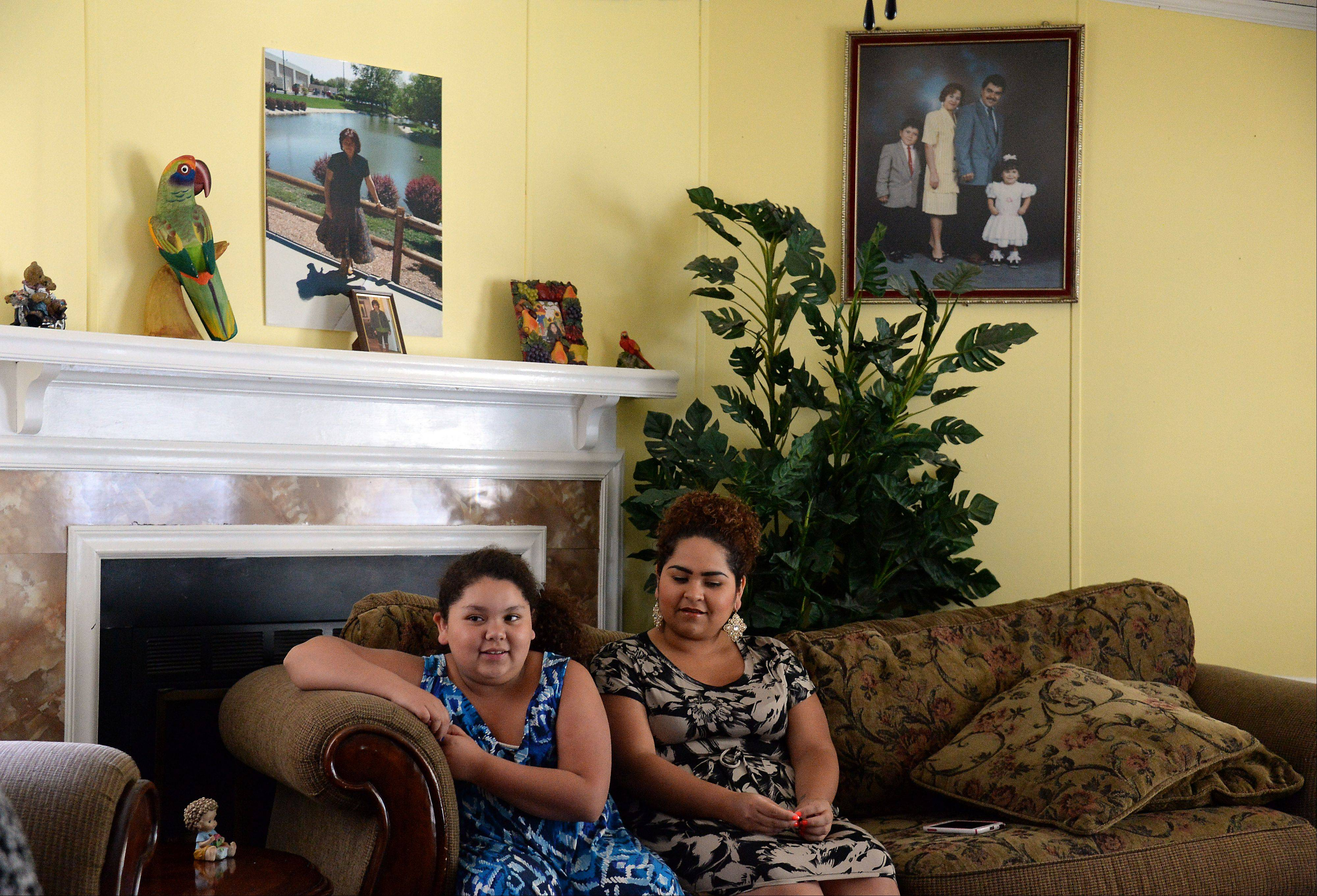 Greta Ramirez, left, and her sister Karen were able to stay together in their home after a family tragedy thanks in large part to the help and support they received from friends and acquaintances.