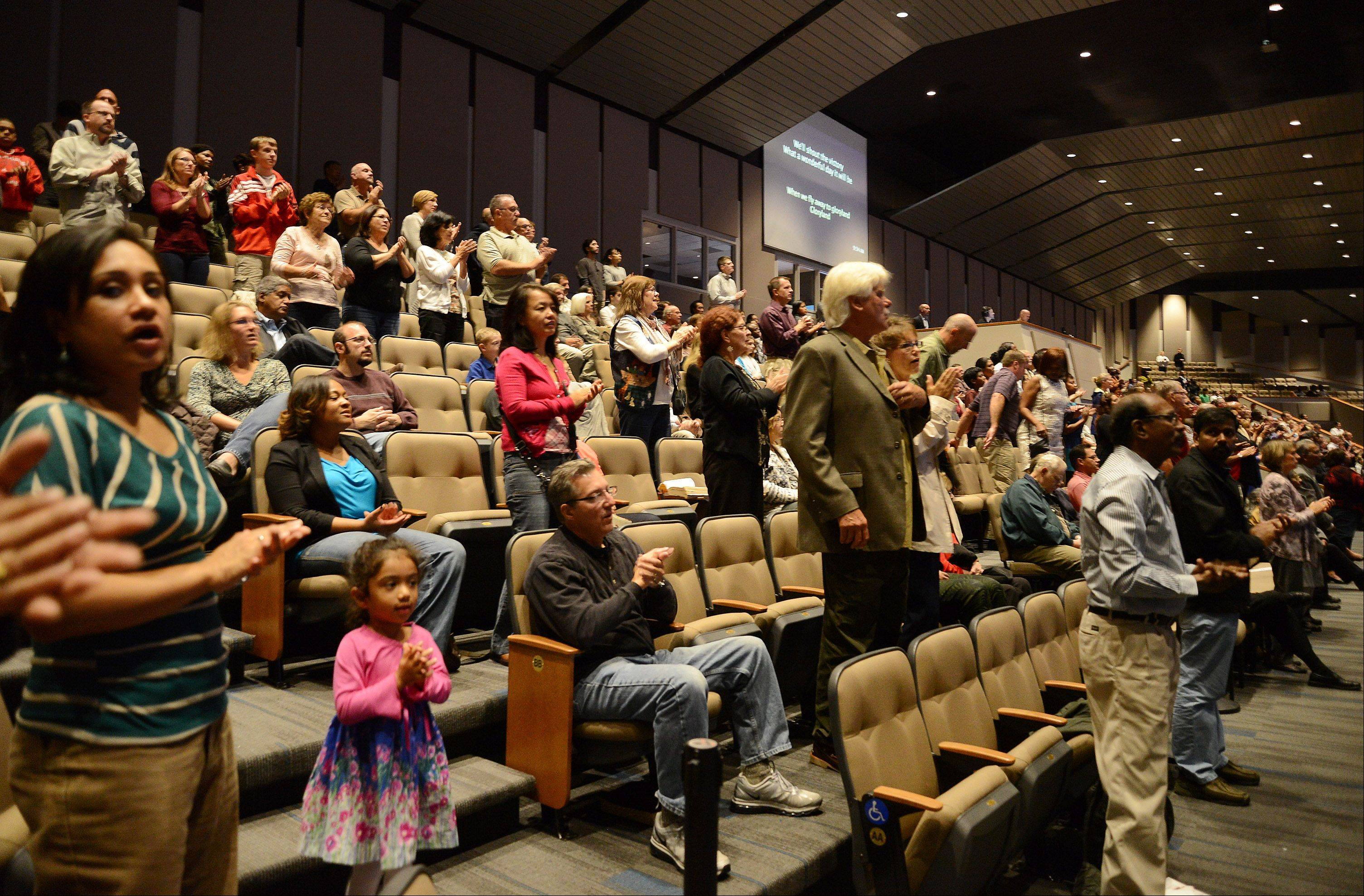 Calvary Church in Naperville opened its newly renovated auditorium after more than five months of construction. The choir and orchestra lead the congregation through a history of worship.