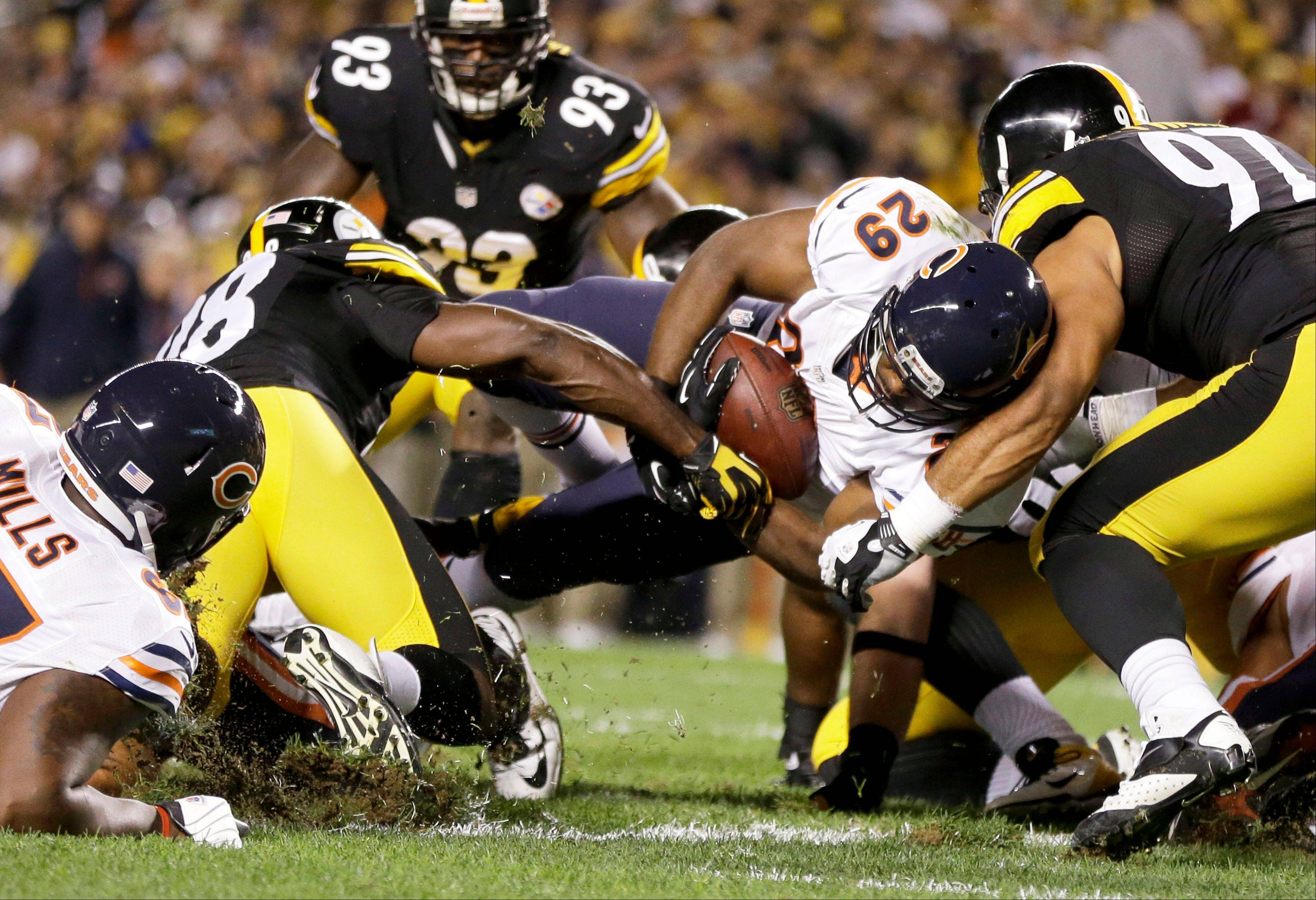 Bears running back Michael Bush scores a touchdown between Steelers linebacker Vince Williams (98) and defensive end Cameron Heyward (97) in the first quarter Sunday at Pittsburgh.