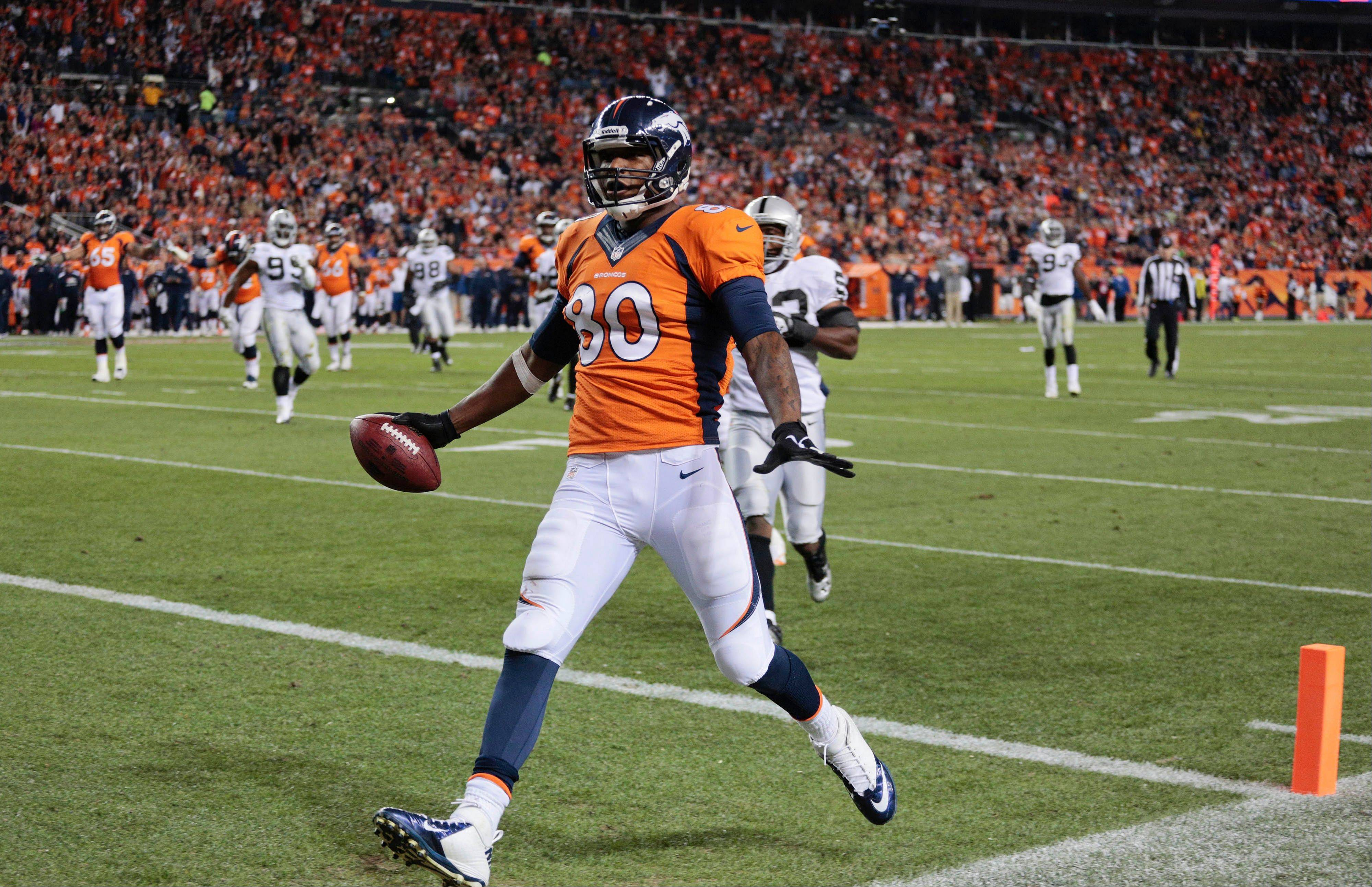 Denver tight end Julius Thomas crosses the goal line for a touchdown Monday night at home against the Oakland Raiders.