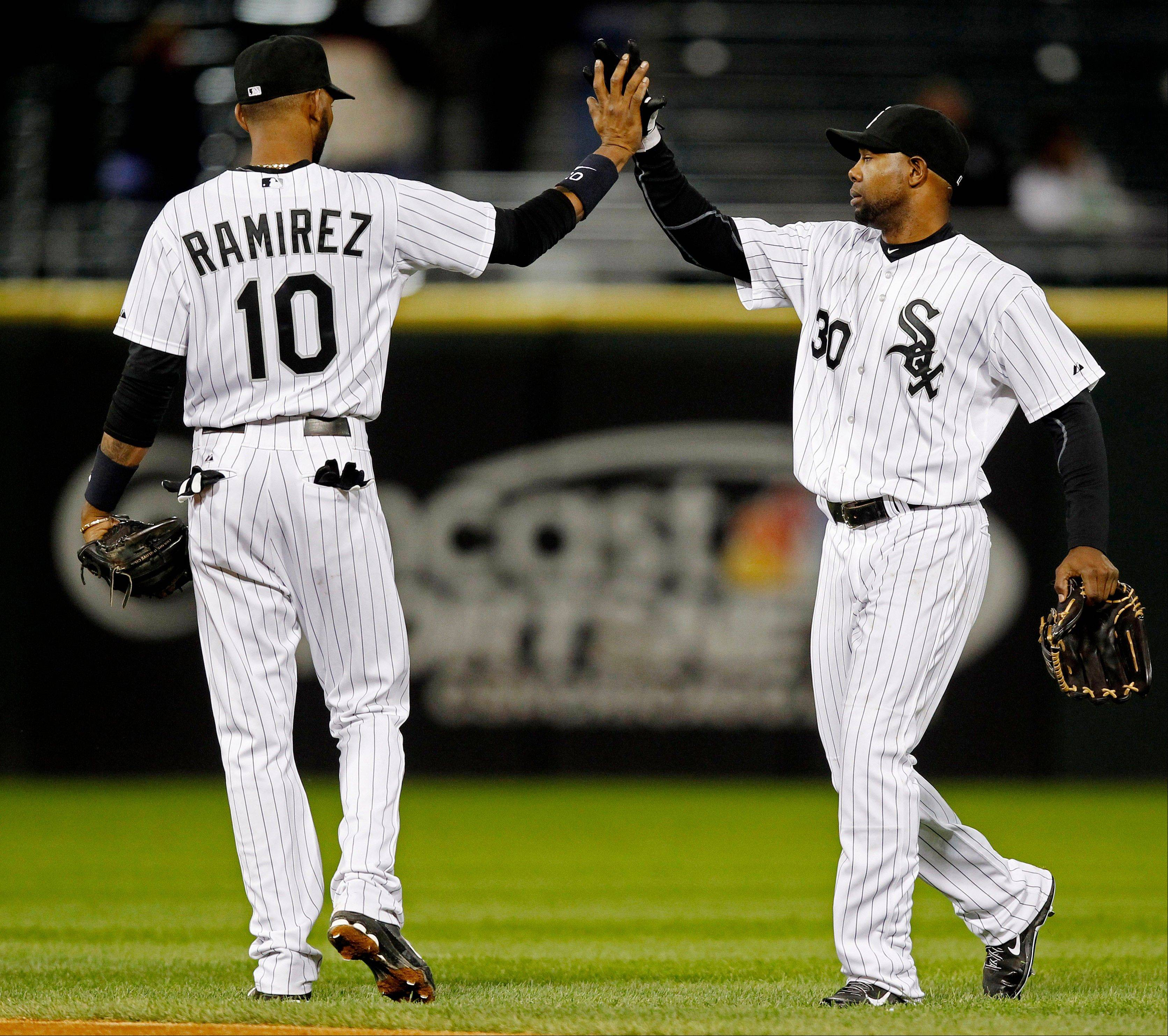 Chicago White Sox shortstop Alexei Ramirez and center fielder Alejandro De Aza celebrate their 3-2 victory against the Toronto Blue Jays in a baseball game on Monday in Chicago.