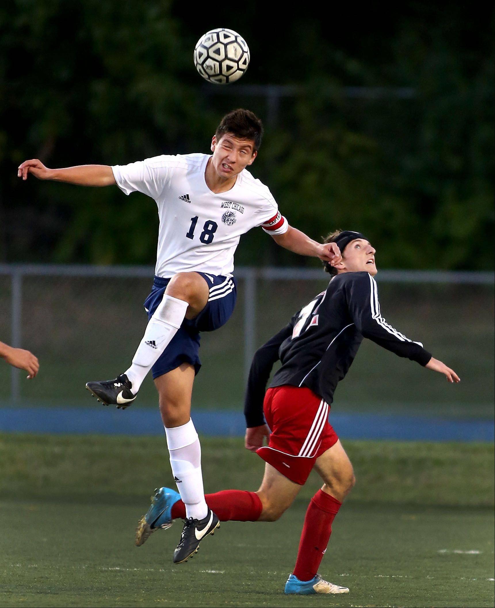 Jesus Fernandez of West Chicago, left, gets to the header before Kyle Kenagy of Benet Academy in boys soccer action on Monday.