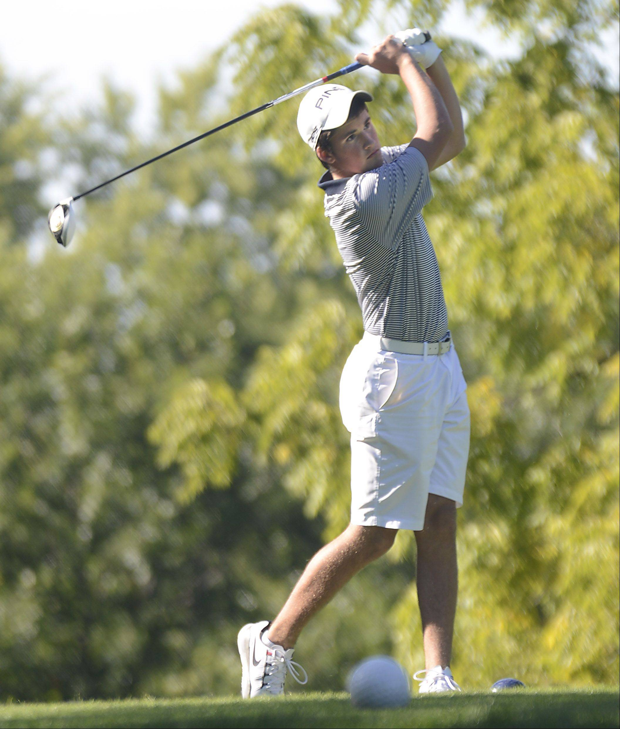 Neuqua Valley's Ian Langton tees off Monday at the Elgin boys golf invitational at Bartlett Golf Club.