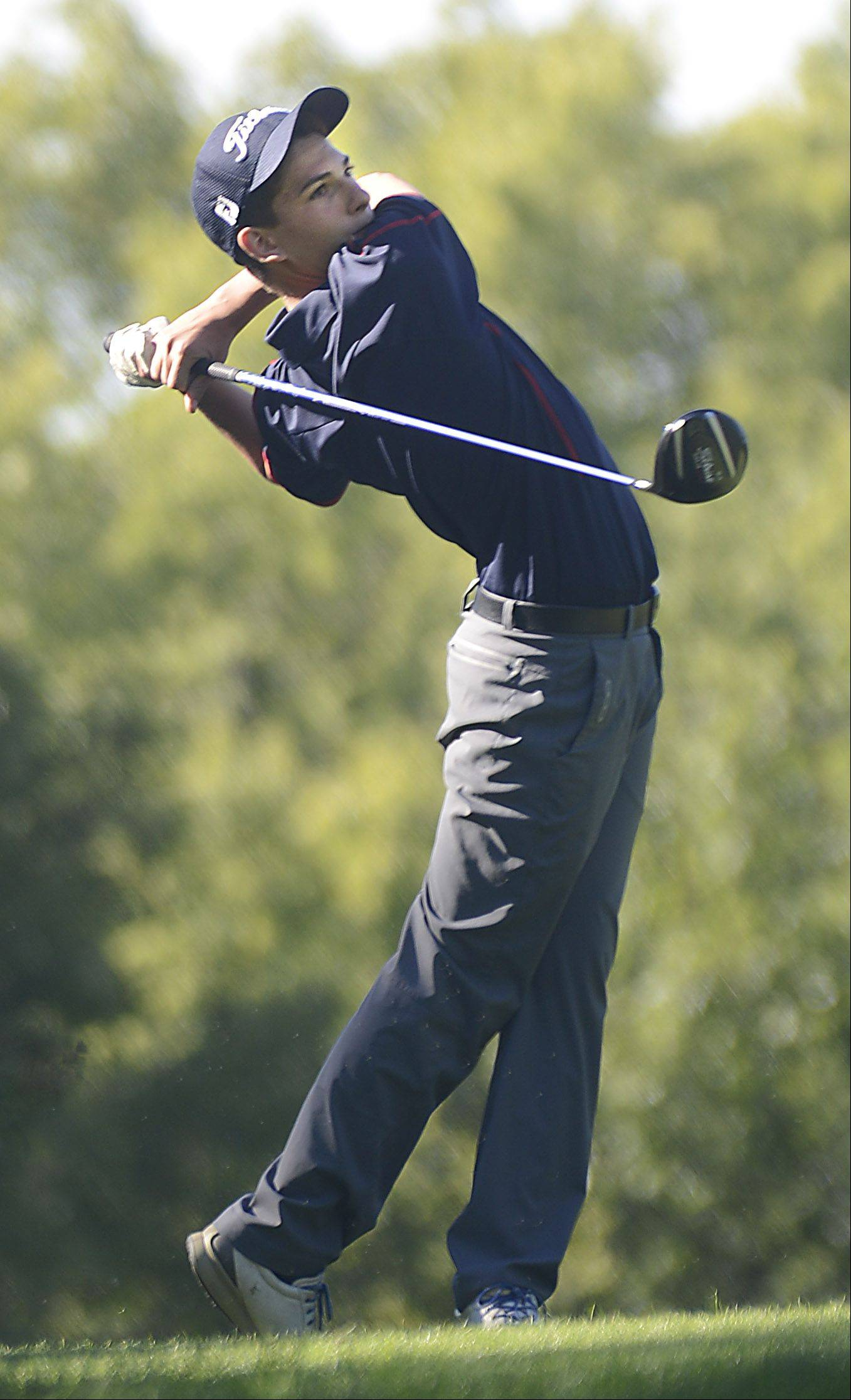 South Elgin's Devin Meredith tees off on No. 11 Monday at the Elgin boys golf invitational at Bartlett Golf Club.
