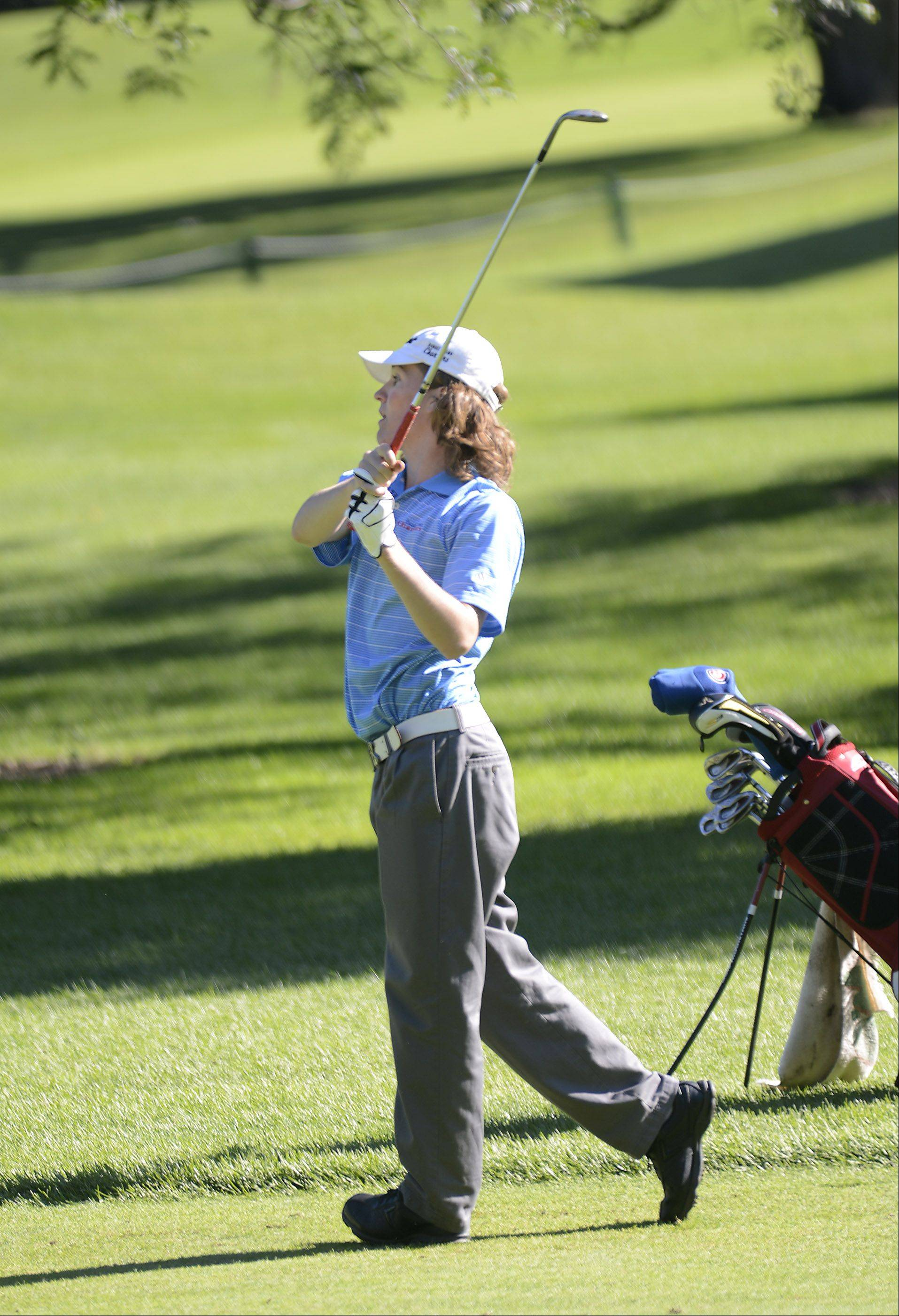 Dundee-Crown's Shane Lubecker hits from the fairway Monday at the Elgin boys golf invitational at Bartlett Golf Club.