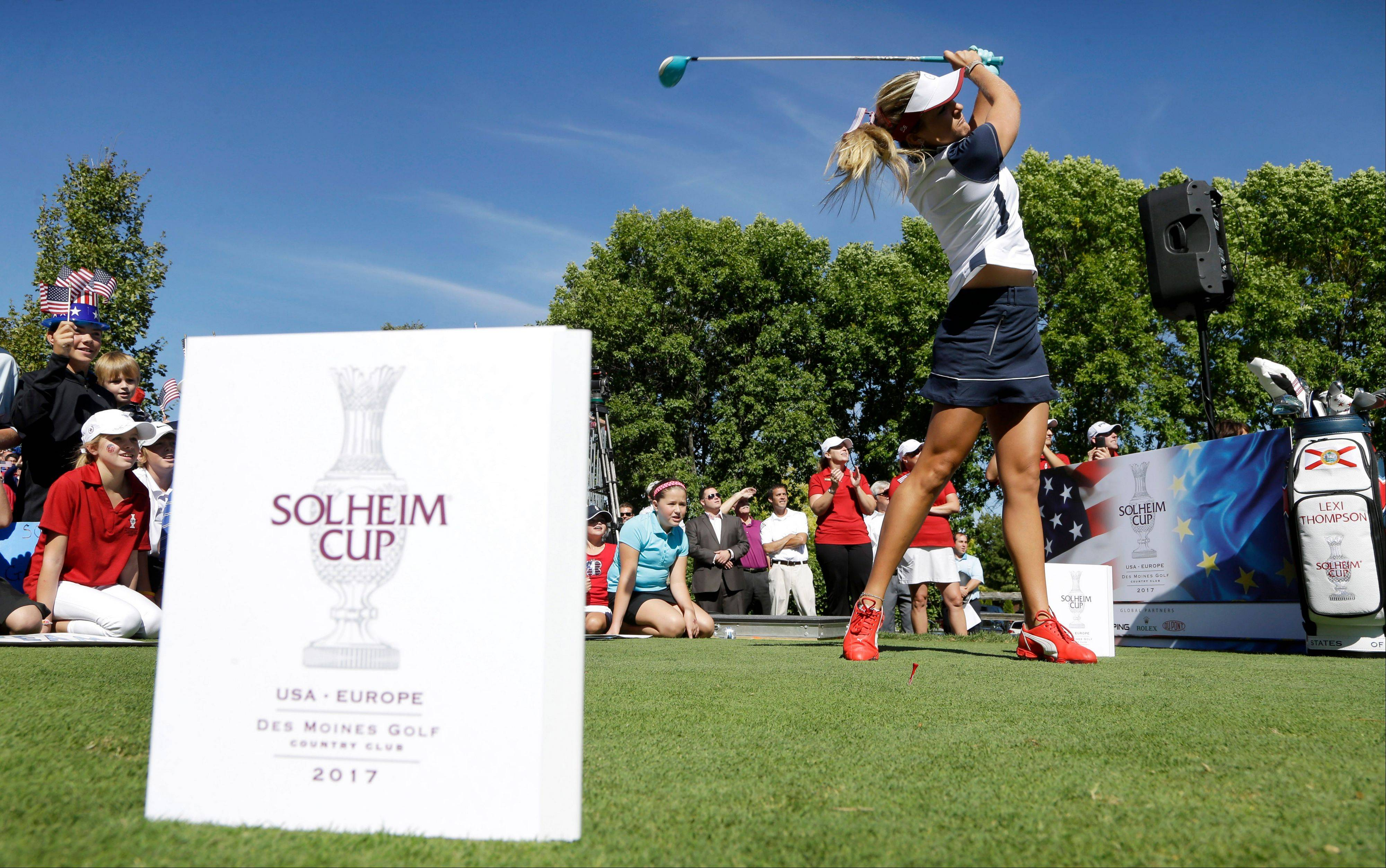 LPGA golfer Lexi Thompson hits a ball off a tee Monday following an announcement that the Solheim Cup will be held at the Des Moines Golf and Country Club in 2017.