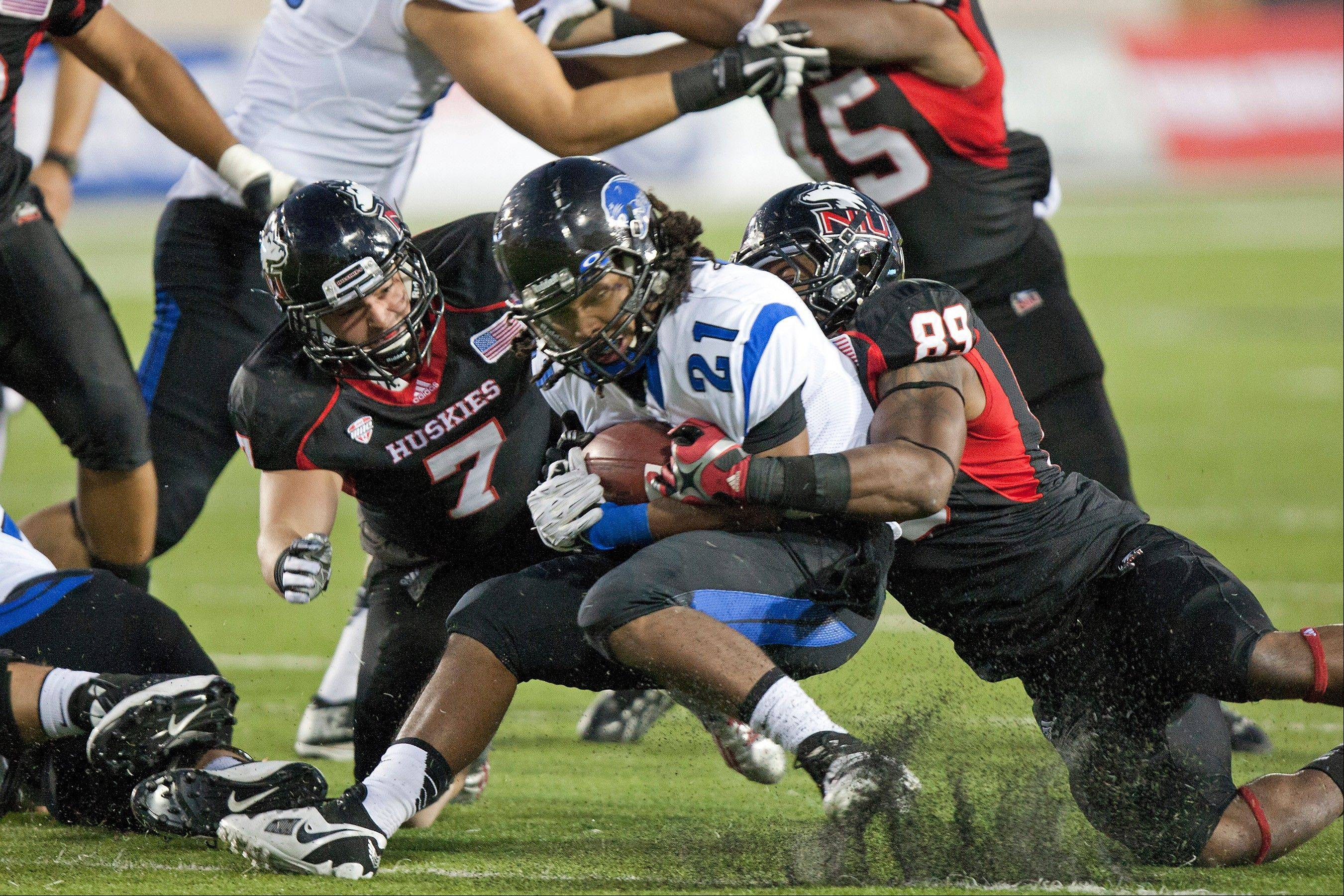 Michael Santacaternina (7) and Stephen O'Neal (89) of Northern Illinois helped the Huskies come back to defeat Eastern Illinois on Saturday and run their Huskie Stadium winning streak to 22-0.