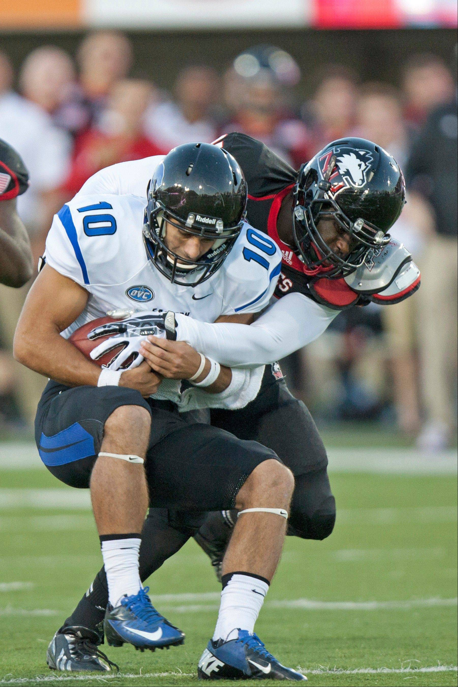 Perez Ford of Northern Illinois tackles Eastern Illinois quarterback Jimmy Garoppolo in their high-scoring game Saturday. Ford leads NIU with 3.5 sacks on the season. Garoppolo, a Rolling Meadows grad, had 6 touchdown passes against NIU.