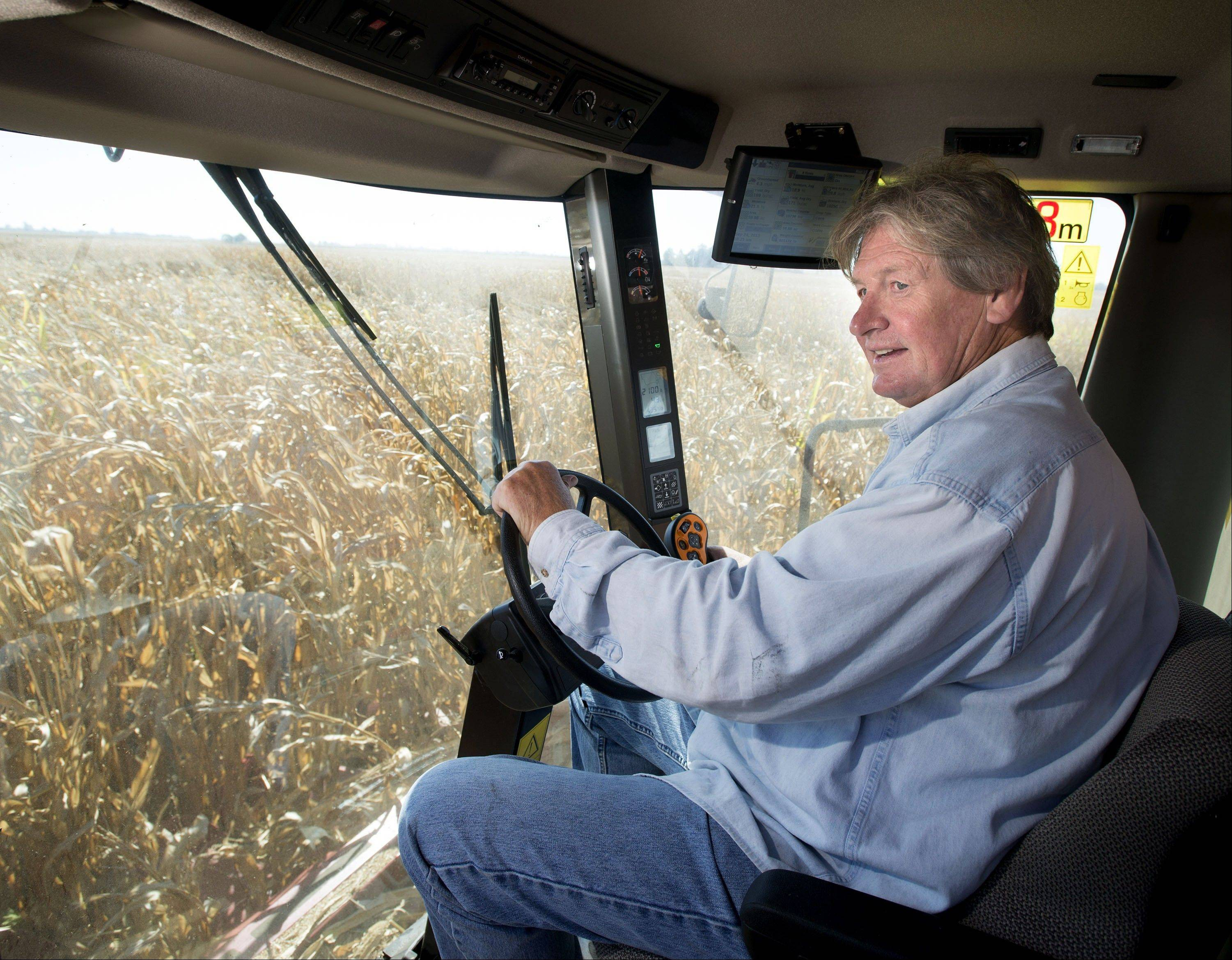 Rick Schmidt drives a combine Tuesday through an 80-acre corn field two miles west of Thomasboro, Ill. Farmers planted the most corn in 80 years this year, and favorable weather, compared to last year�s drought, has boosted the chances of a good harvest.