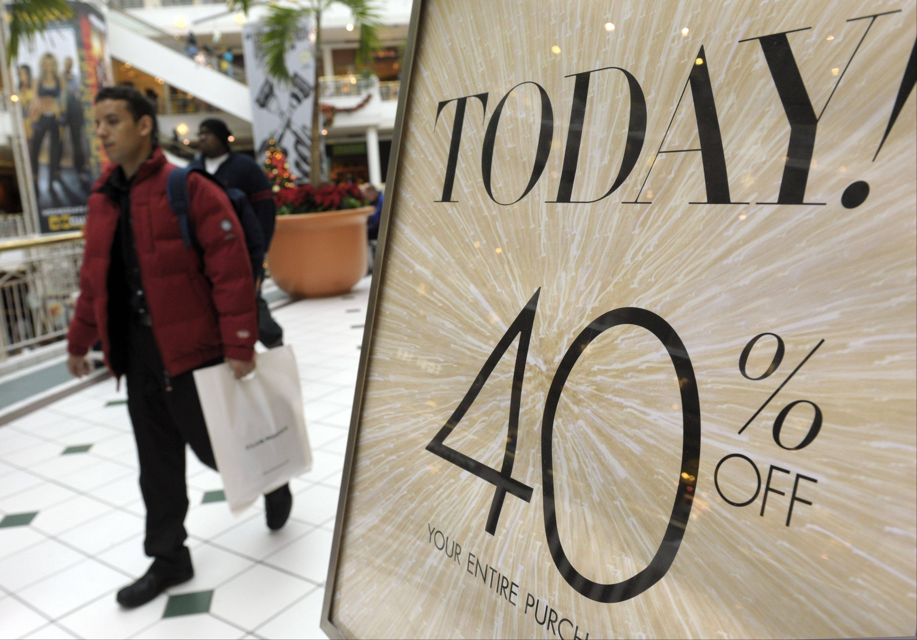 Holiday hiring by U.S. retailers may fall about 6.9 percent this year as shaky consumer confidence and more efficient store practices reduce demand for seasonal workers, according to Chicago-based Challenger, Gray & Christmas Inc.