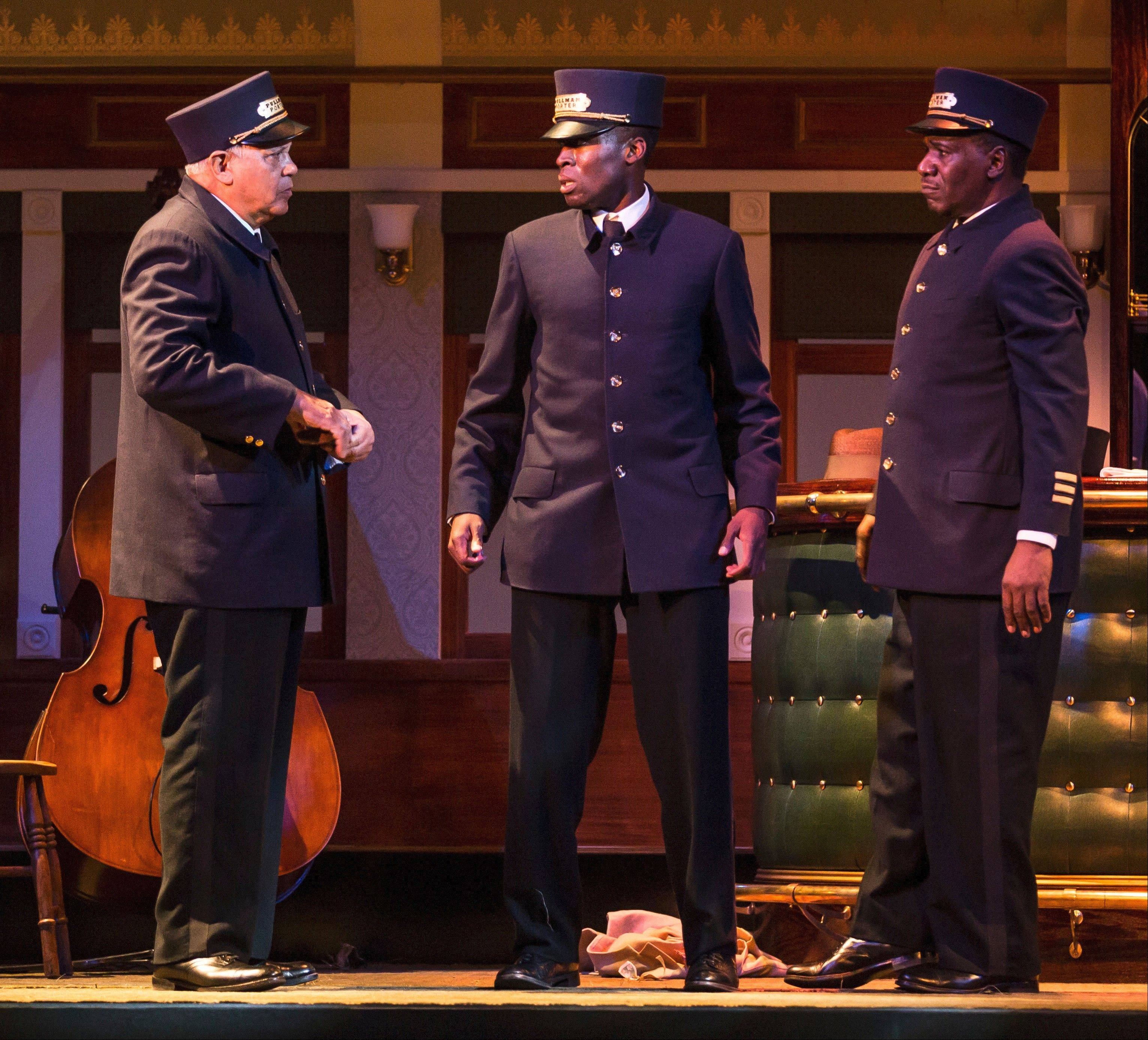 "First-time Pullman Porter Cephas Sykes (Tosin Morohunfola, center) is watched over by his grandfather, Monroe Sykes (Larry Marshall, left), and his father Sylvester (Cleavant Derricks), in Cheryl L. West's 2012 drama ""Pullman Porter Blues"" at the Goodman Theatre in Chicago."