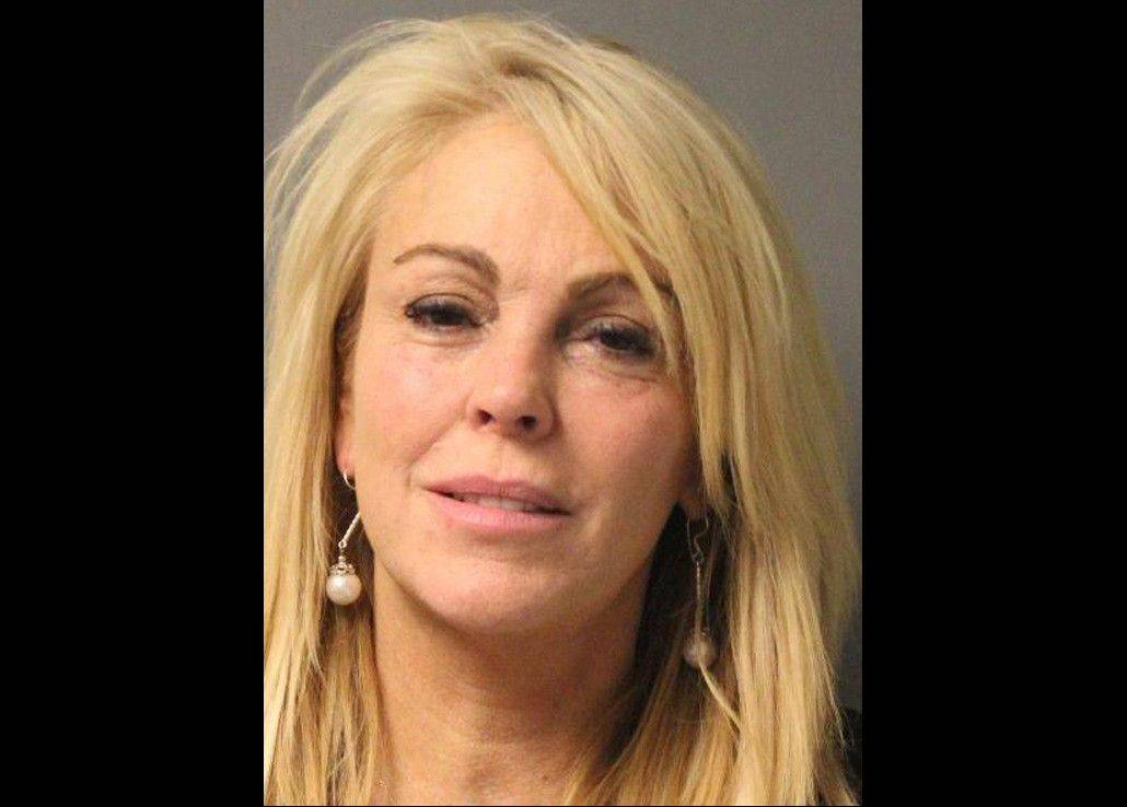 Dina Lohan, mother of Lindsay Lohan, after she was arrested late Thursday, Sept. 12, 2013 on aggravated drunken driving charges. Lohan pleaded not guilty on Tuesday, and a judge suspended her driver's license before releasing her without bail.