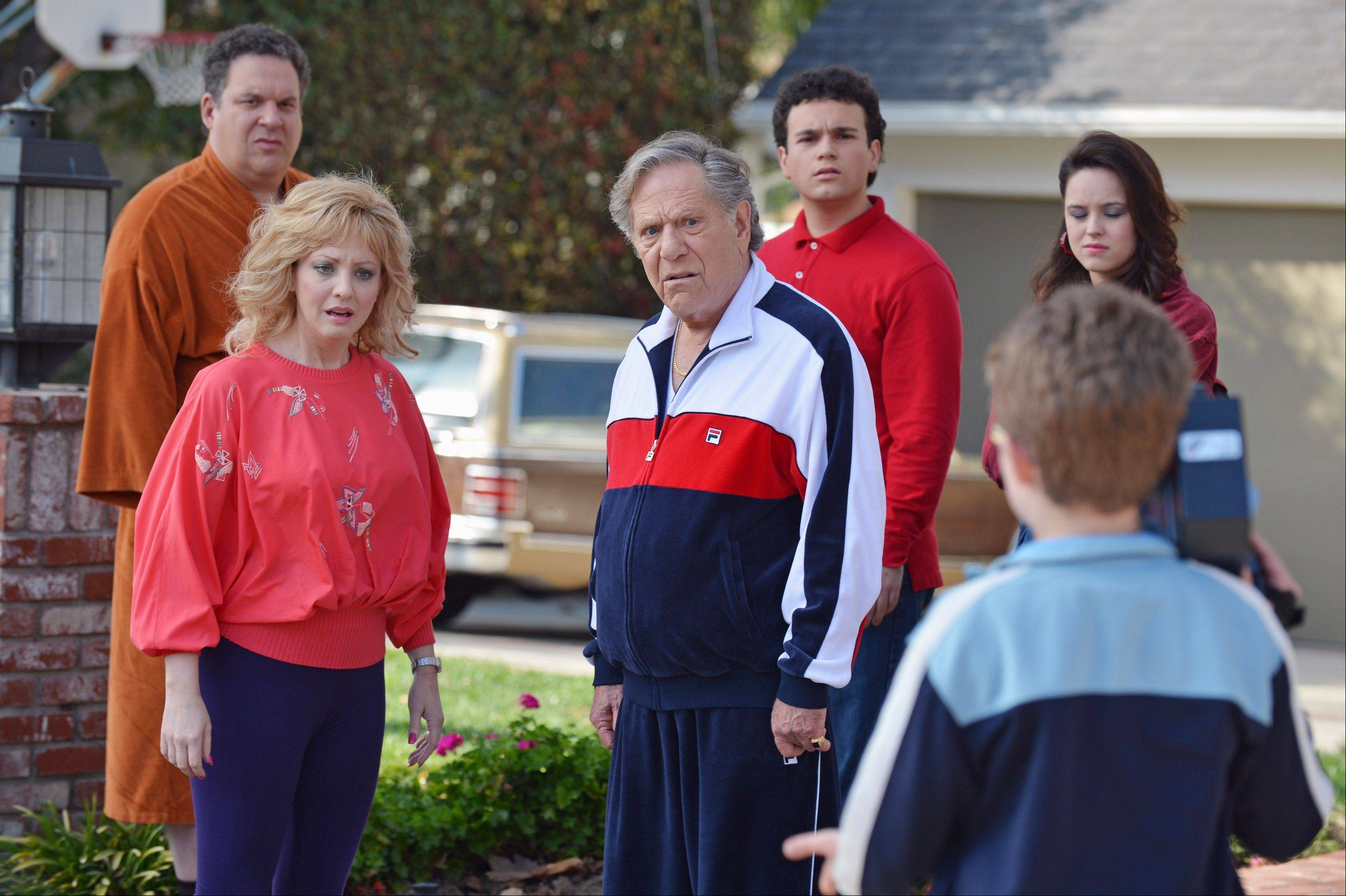 "Morton Grove native Jeff Garlin, left, Wendi McLendon-Covey, George Segal, Troy Gentile, Sean Giambrone and Hayley Orrantia star in ABC's ""The Goldbergs,"" premiering at 8 p.m. Tuesday, Sept. 24."