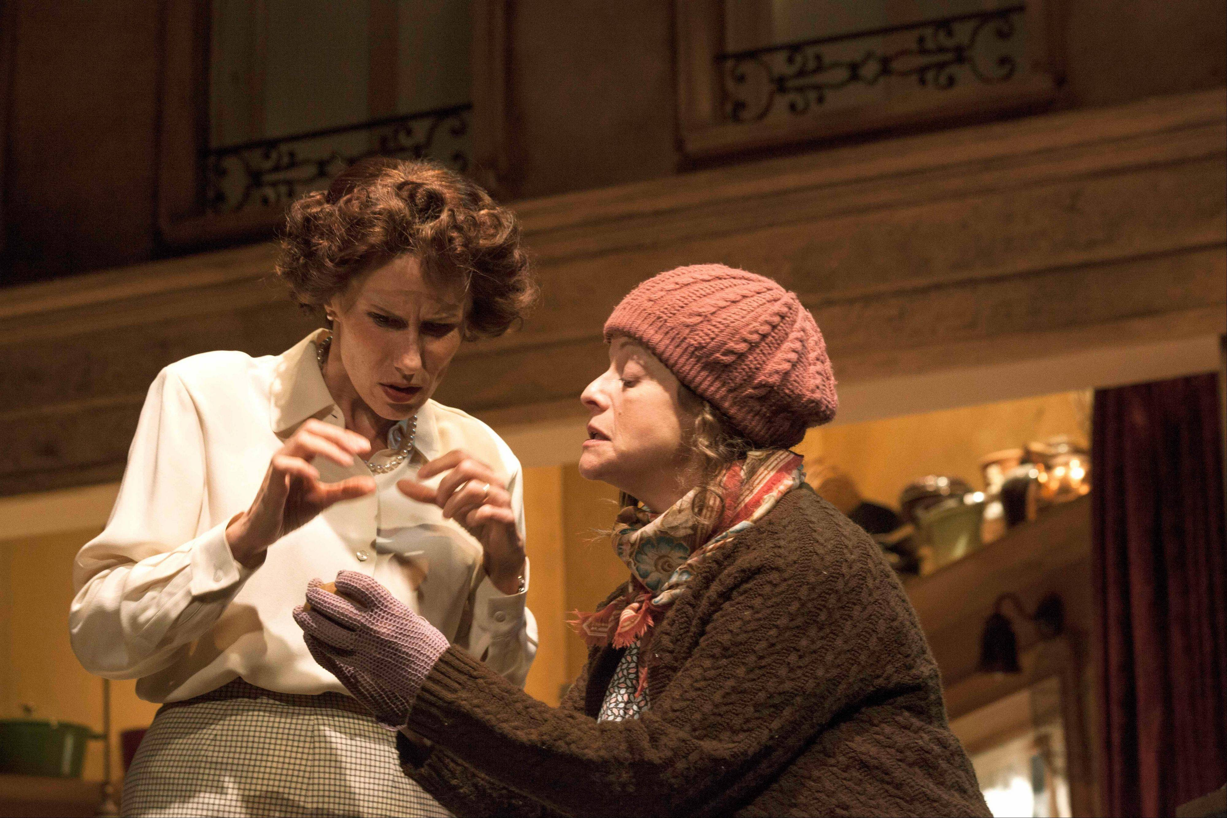 "Marie (Jeannie Affelder), right, instructs Julia (Karen Janes Woditsch) in the delicate art of choosing the perfect vegetable in ""To Master the Art,"" William Brown and Doug Frew's bio-drama running through Oct. 20 at the Broadway Playhouse in Chicago."