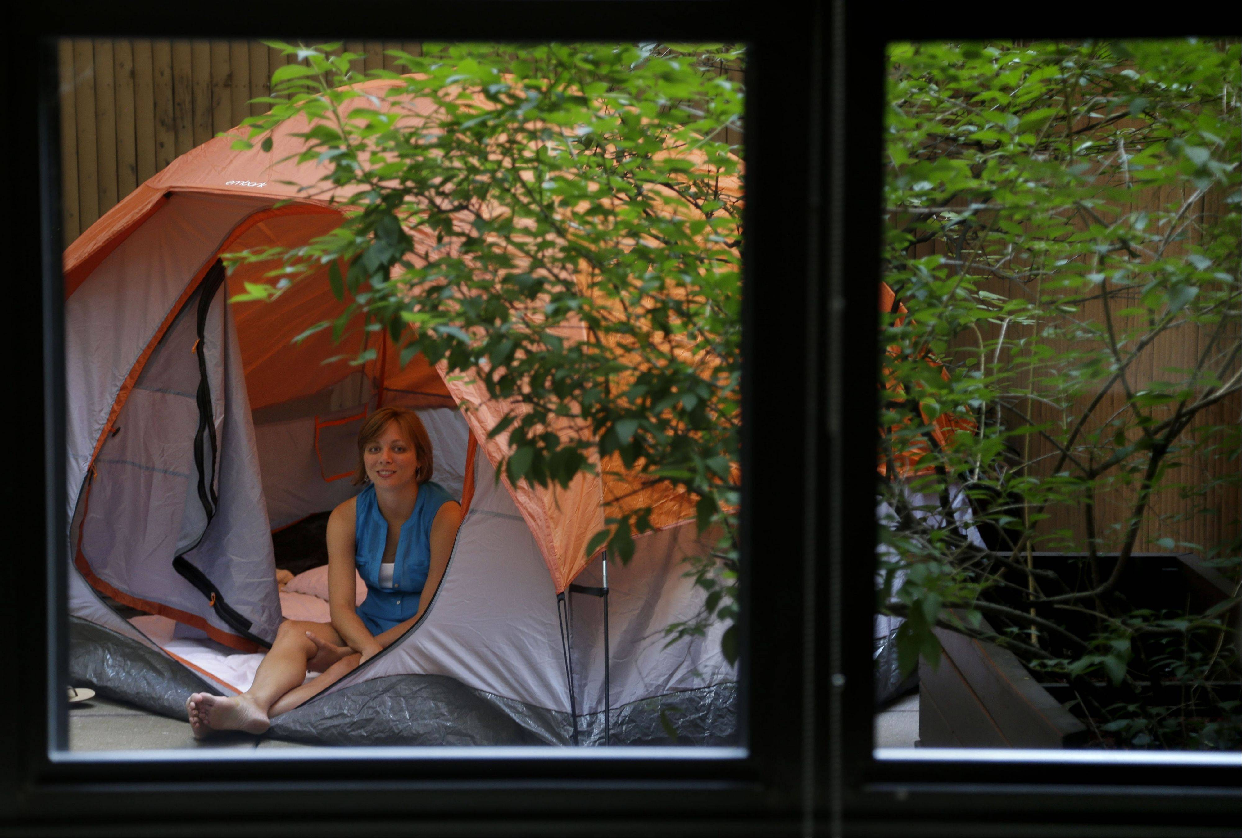 Kathleen Boyle sits in a tent on the patio of her room at the Affina Hotel in New York. A couple of New York City locales are offering an unusual option — the chance to sleep outdoors, incredibly comfortably.