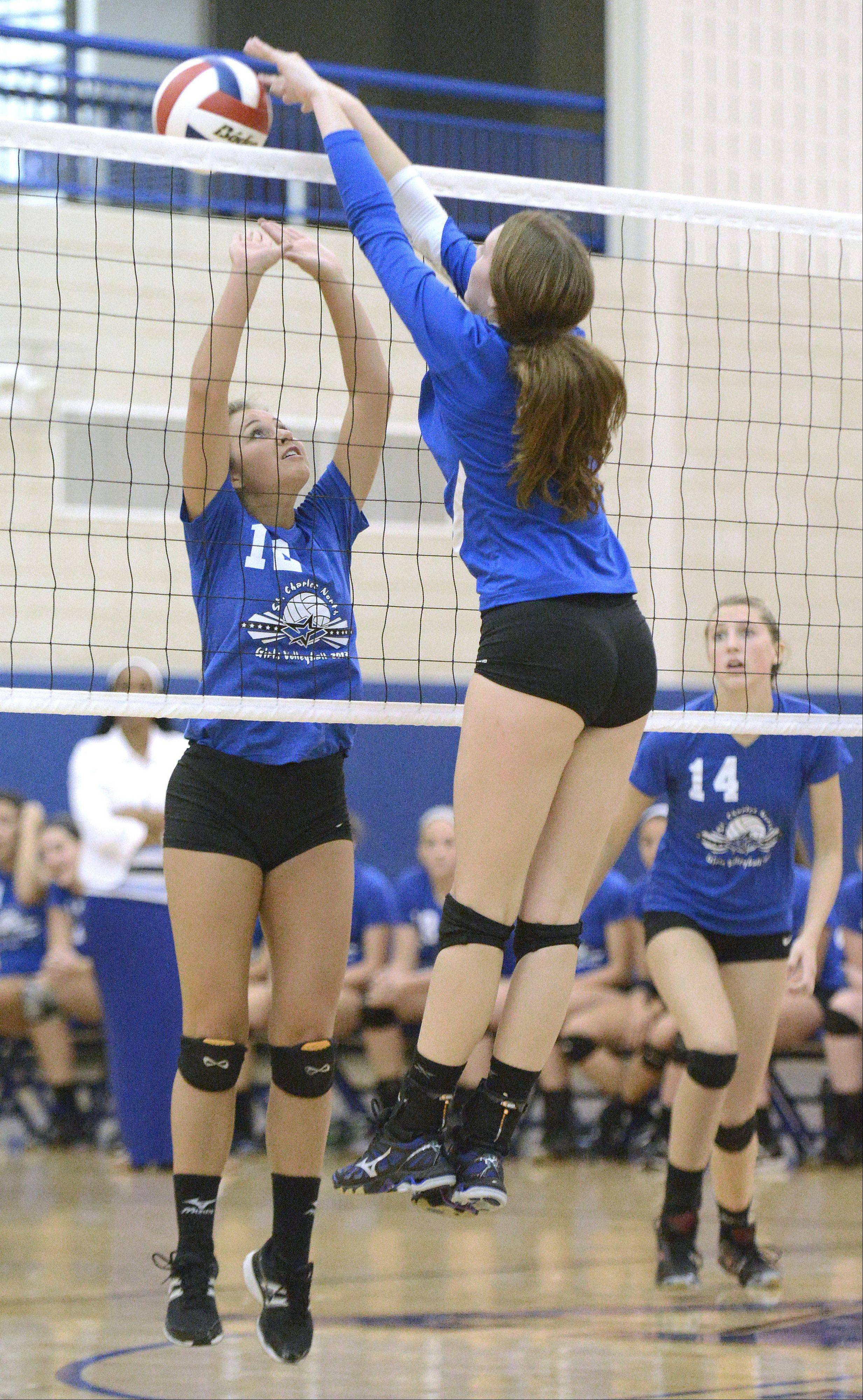 Geneva's Hannah Lanasa tips the ball over the net towards St. Charles North's Sydney Wohlert in the third match on Tuesday, September 24.