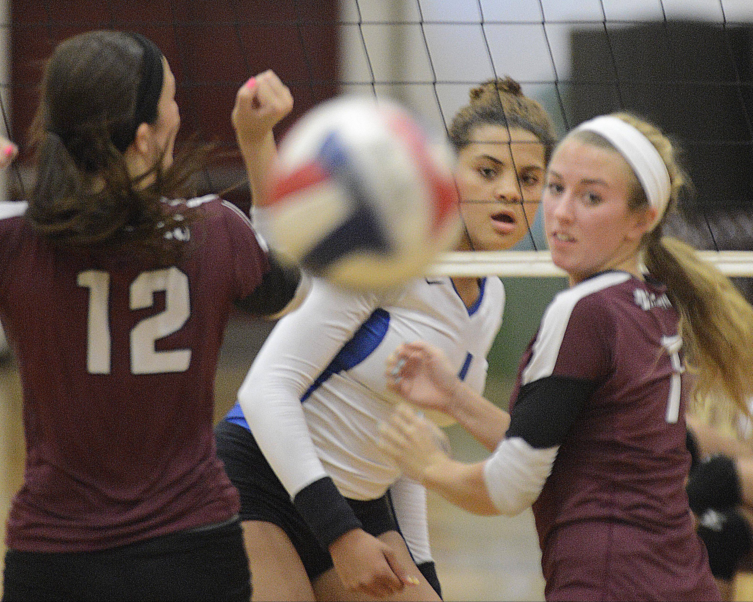 Larkin�s Olivia Kofie watches her spike go past Elgin�s Emma Sirridge and Nikki Zimmer Tuesday in Elgin.