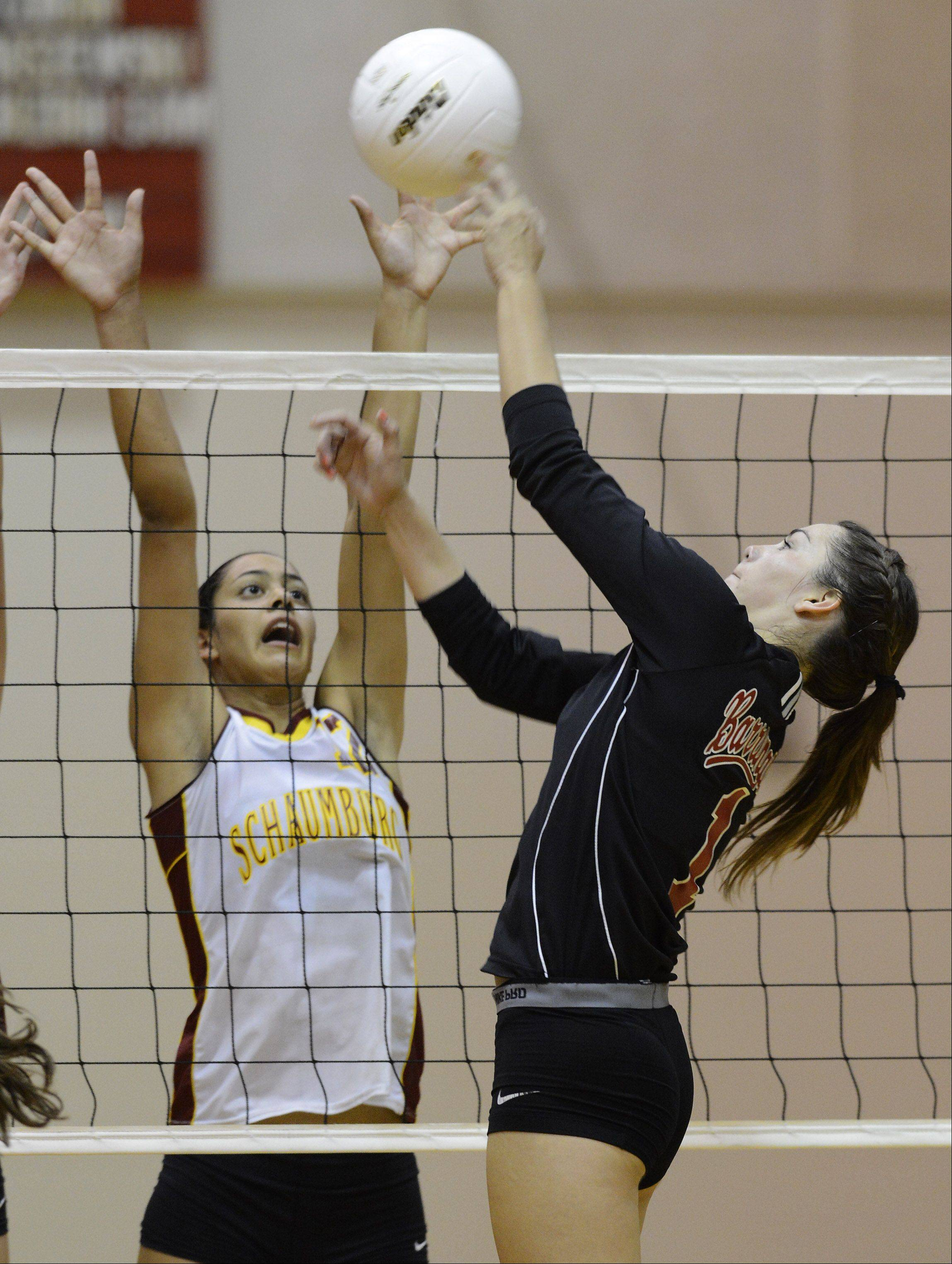 Barrington�s Claire Waliczek, right, tips the ball over the net in front of Schaumburg�s Kiana Lewis.