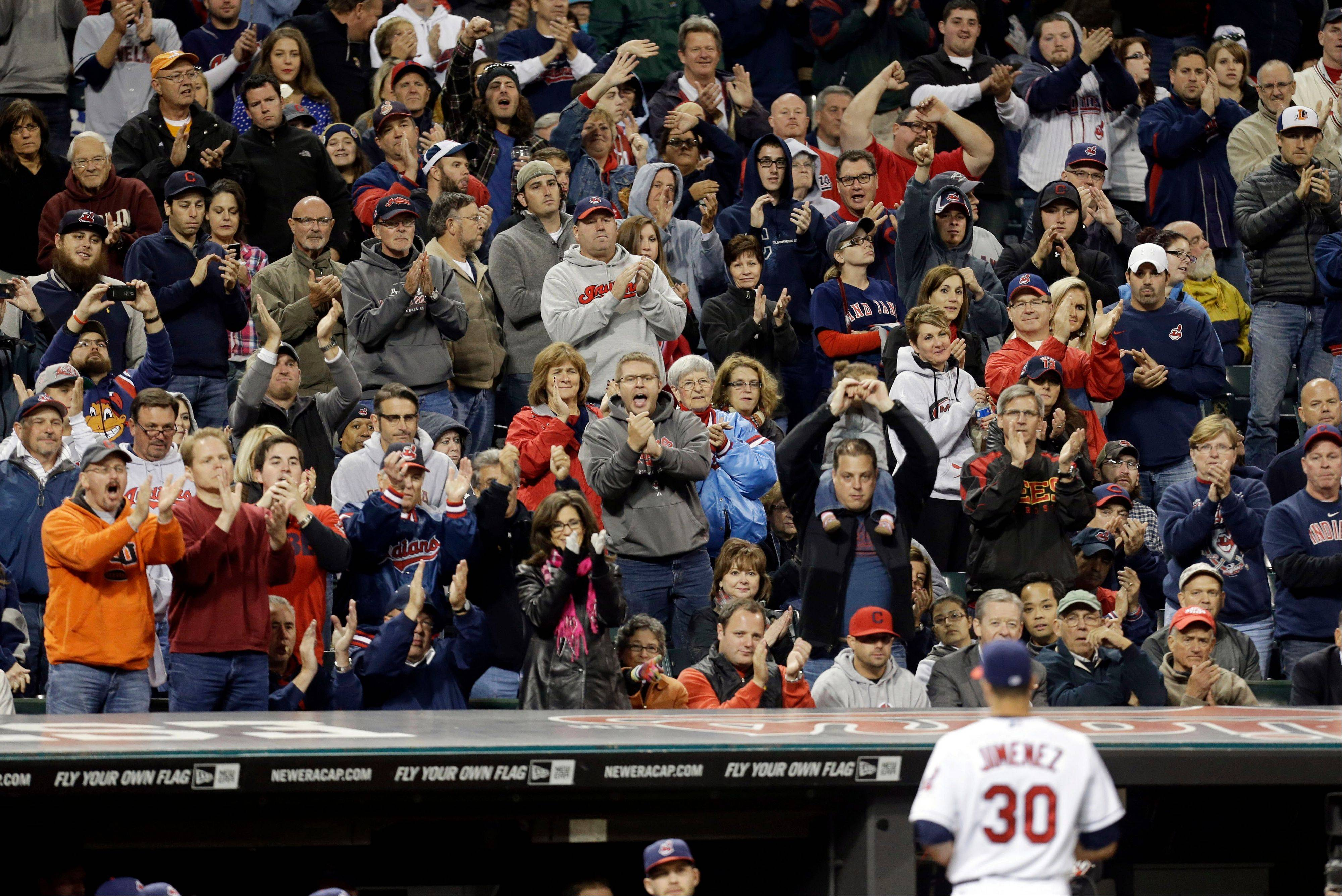 Cleveland Indians fans cheer as starting pitcher Ubaldo Jimenez walks to the dugout in the seventh inning of a baseball game, Tuesday, Sept. 24, 2013, in Cleveland. Jimenez pitched 6 1/3 innings and gave up five hits and two runs.