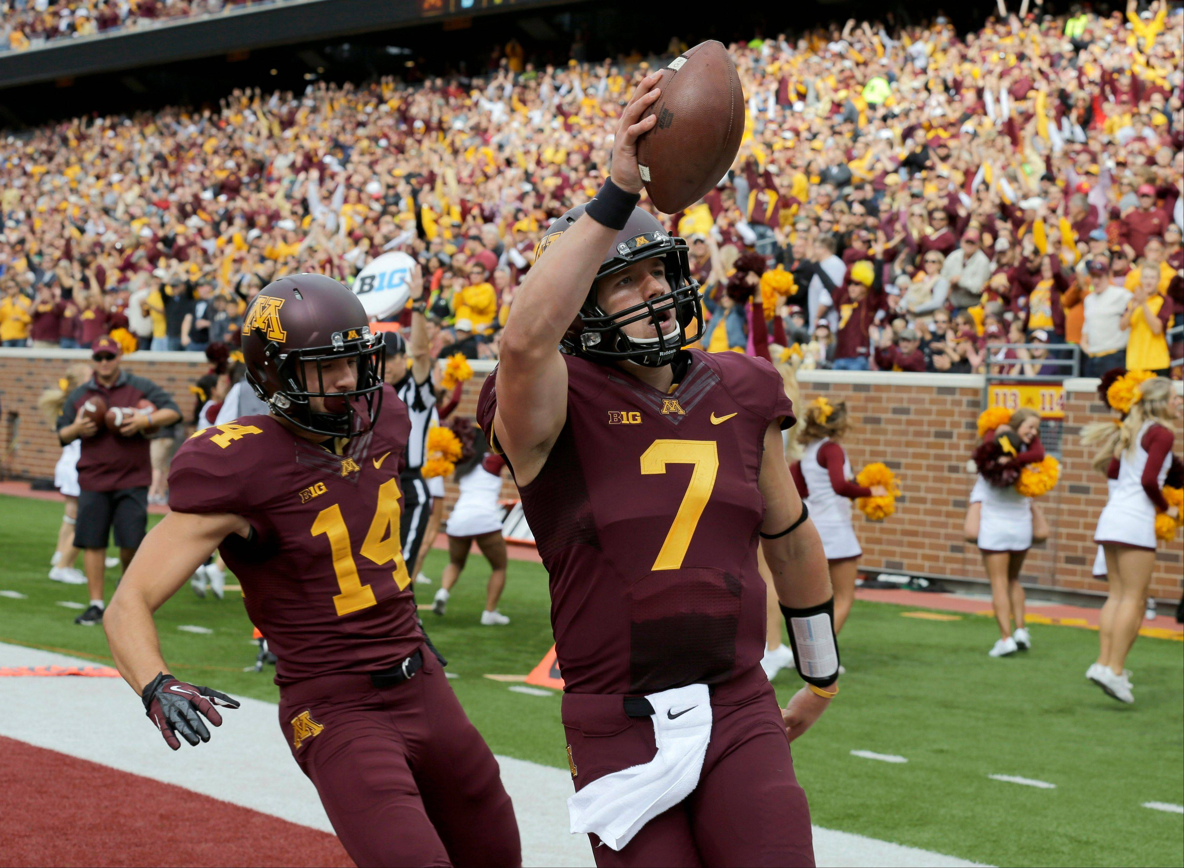 Minnesota quarterback Mitch Leidner celebrates his touchdown with wide receiver Isaac Fruechte (14) last Saturday at home against San Jose State. Minnesota won 43-24.