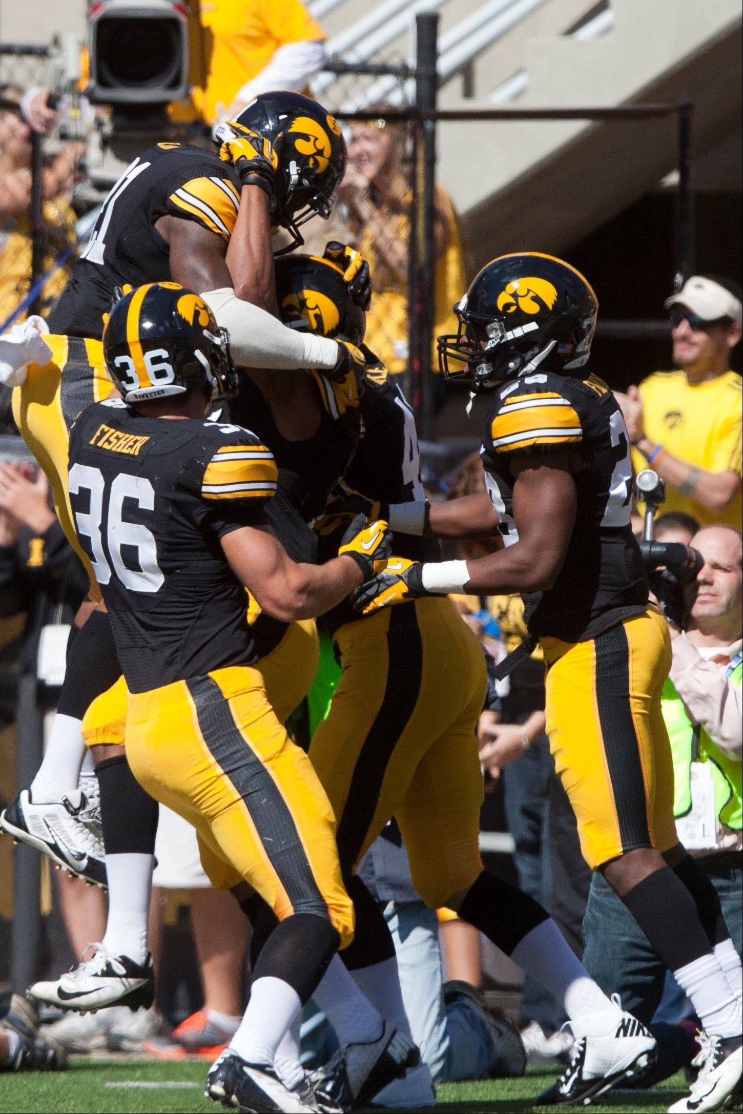 Iowa wide receiver Kevonte Martin-Manley, top left, celebrates with teammates after scoring a touchdown against Western Michigan on Saturday in Iowa City.