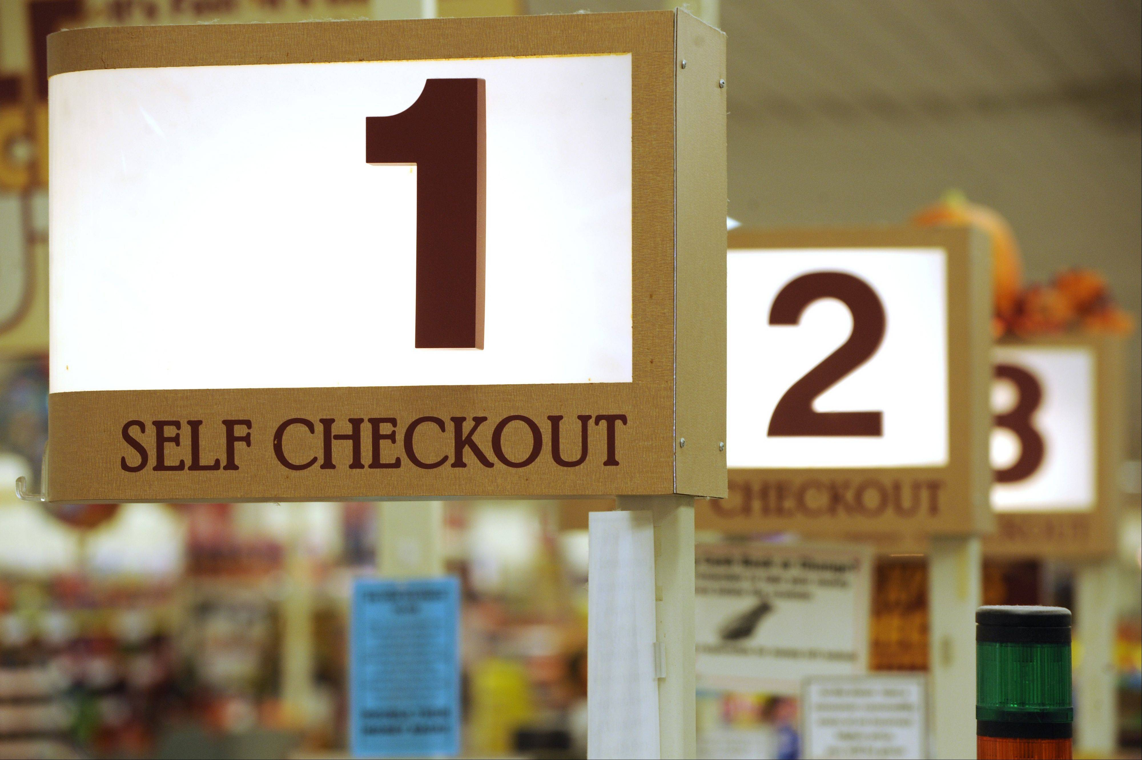 Self checkout lanes, like these at a Connecticut supermarket, are losing favor at some grocery chains, including Jewel-Osco, which intends to emphasize personal service instead.