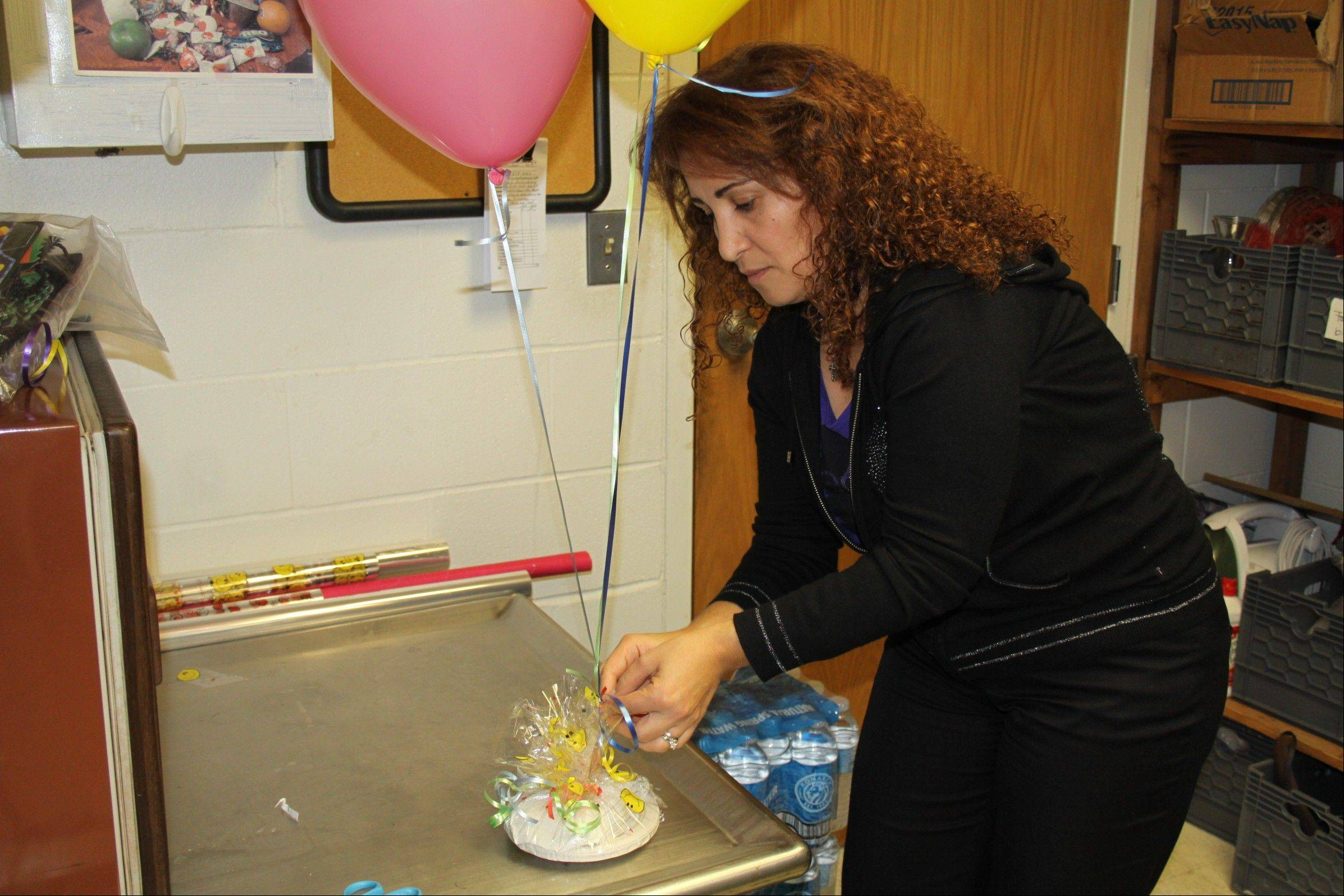 "Lina Hajj, a dining services staff member at Connecticut College in New Haven, Conn., assembles a ""birthday bash"" care package that parents can order online for pickup by their kids on campus."