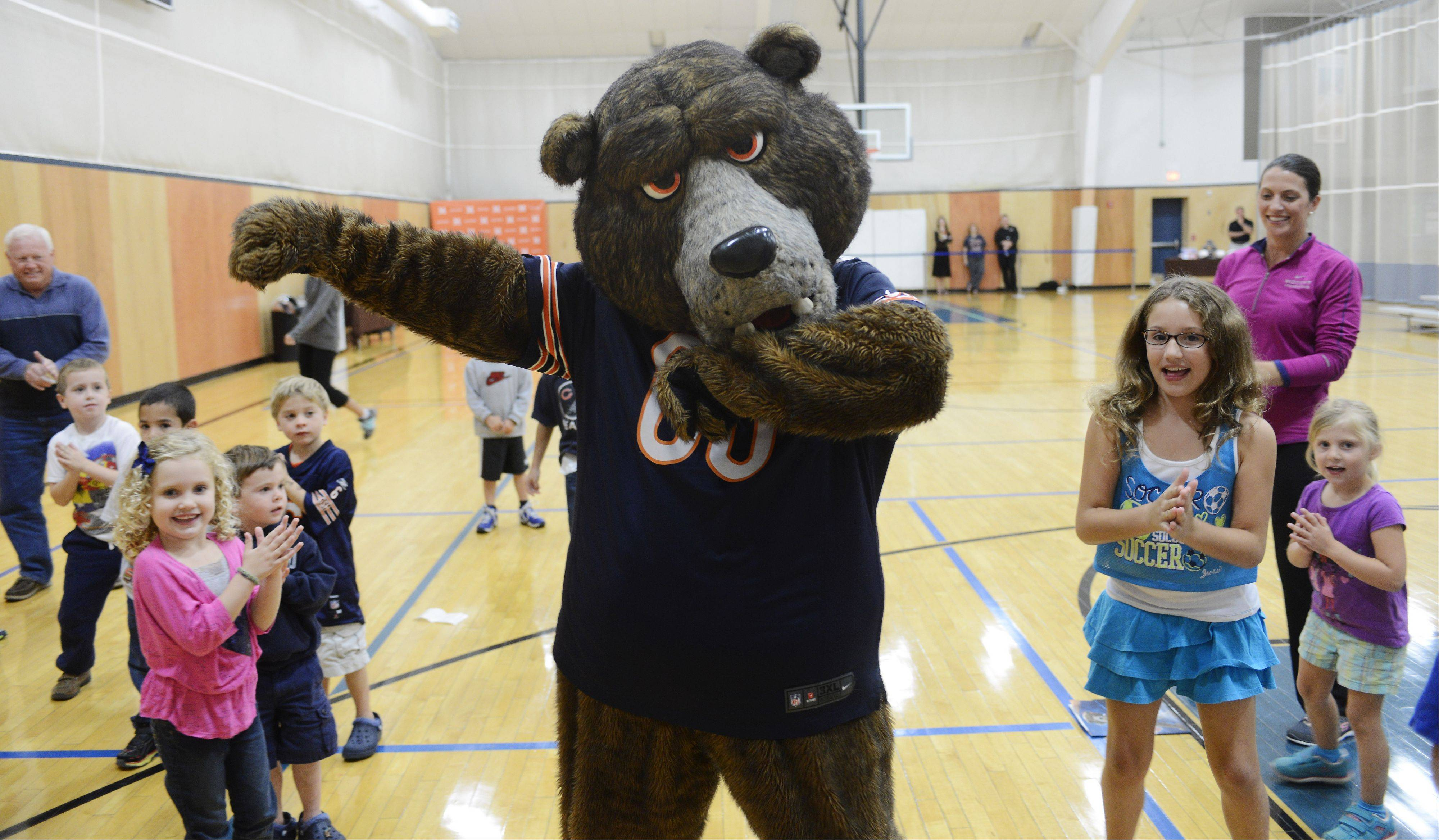 Staley 'Da Bear' dances with kids during a fitness event for children Tuesday at the Midtown Athletic Club in Palatine. Joining Staley at the event was Bears safety Craig Steltz.