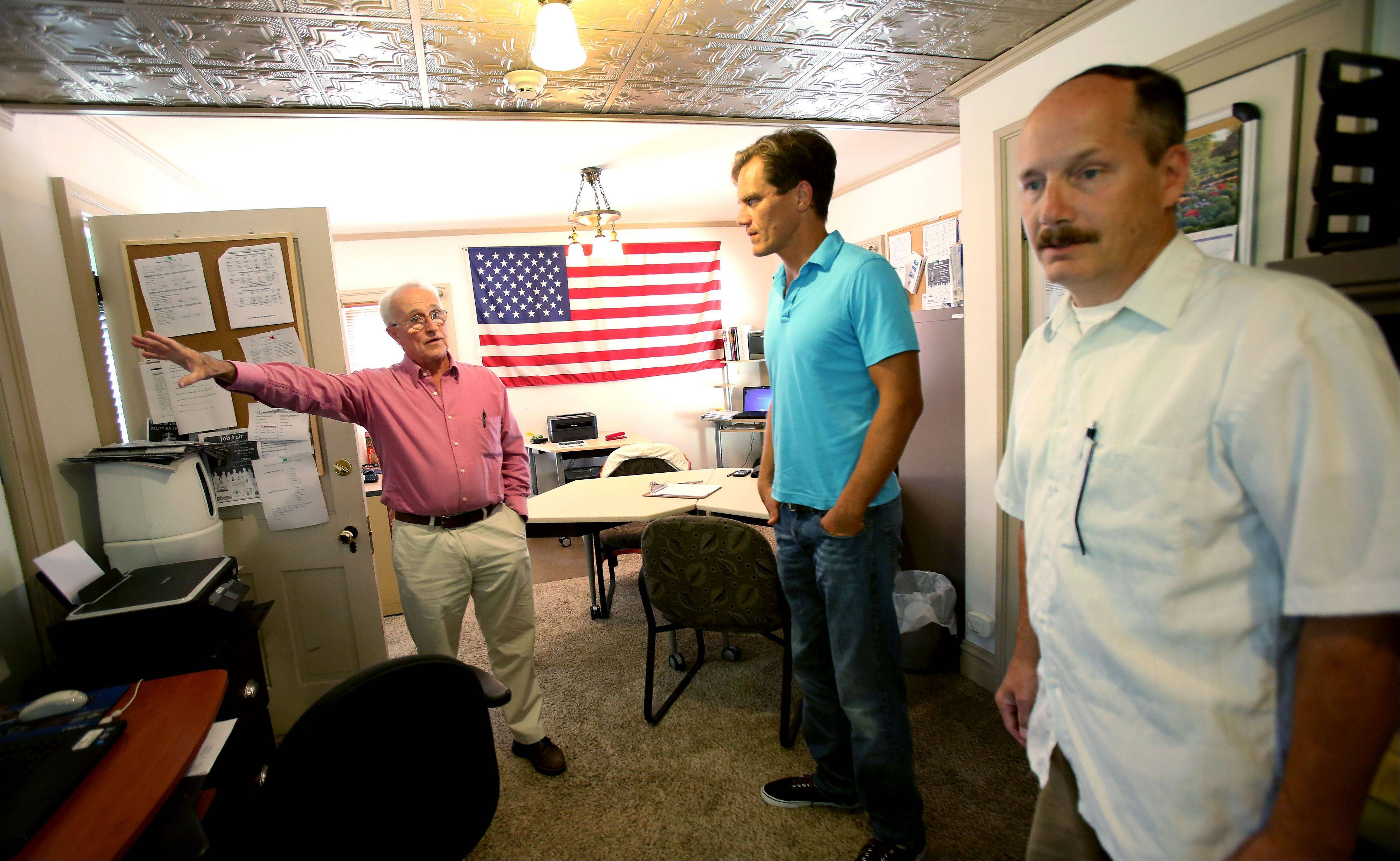 Bob Adams, left, shows actors Michael Shannon, center, and Guy Van Swearingen the Midwest Shelter for Homeless Veterans in Wheaton.