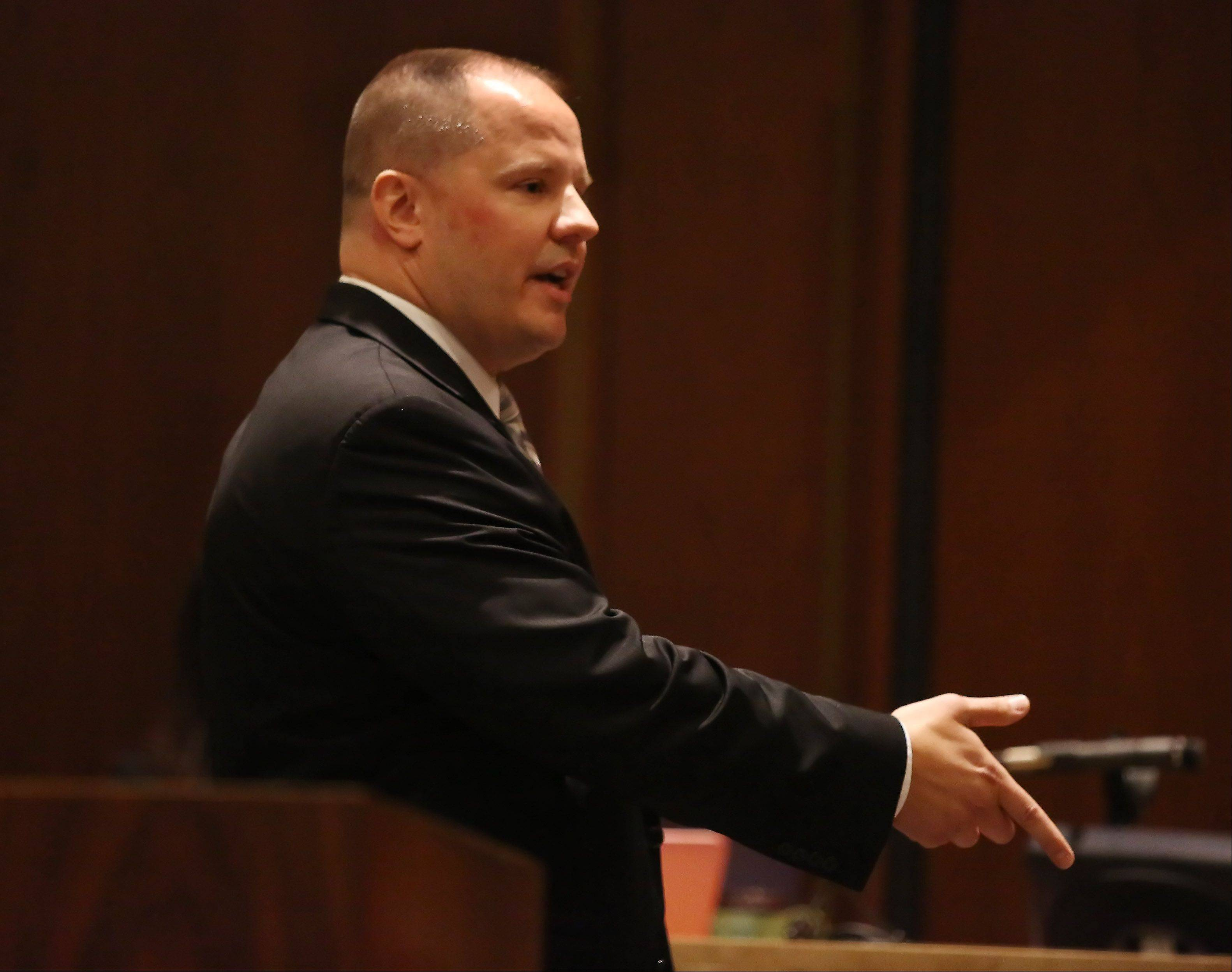 Lake County Assistant State's Attorney Eric Kalata gives opening statements during the murder trial of Montago Suggs of Kenosha, Wis., Tuesday at the Lake County courthouse in Waukegan. Suggs is accused of killing Melinda Morrell of Round Lake Park during a robbery at a check cashing store in Waukegan in 2007.