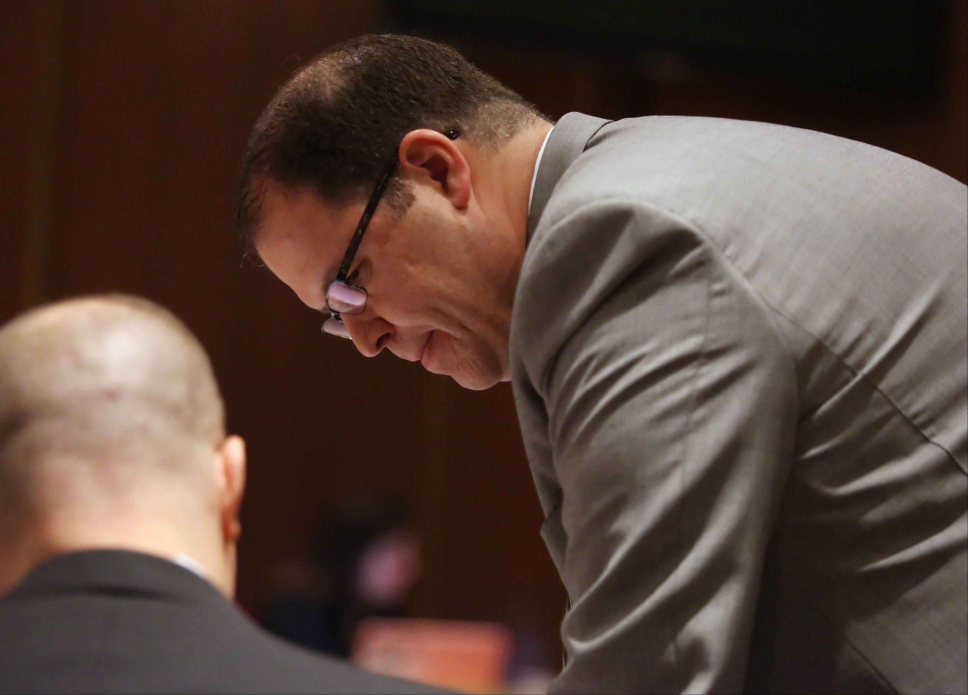 Lake County Assistant State's Attorney Ari Fisz discusses evidence during the murder trial of Montago Suggs of Kenosha, Wis., Tuesday at the Lake County courthouse in Waukegan. Suggs is accused of killing Melinda Morrell of Round Lake Park during a robbery at a check cashing store in Waukegan in 2007.