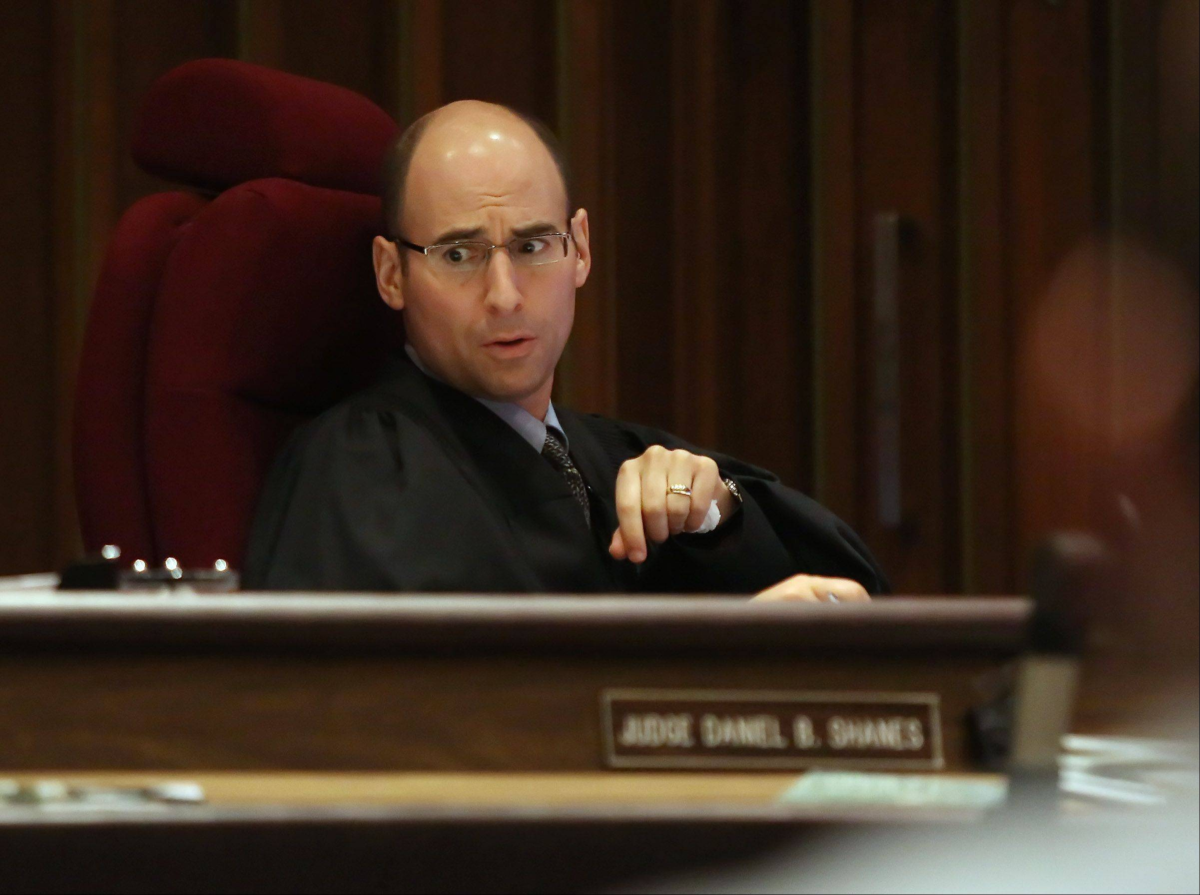 Lake County Judge Daniel B. Shanes listens to an objection during the murder trial of Montago Suggs of Kenosha, Wis., Tuesday at the Lake County courthouse in Waukegan. Suggs is accused of killing Melinda Morrell of Round Lake Park during a robbery at a check cashing store in Waukegan in 2007.