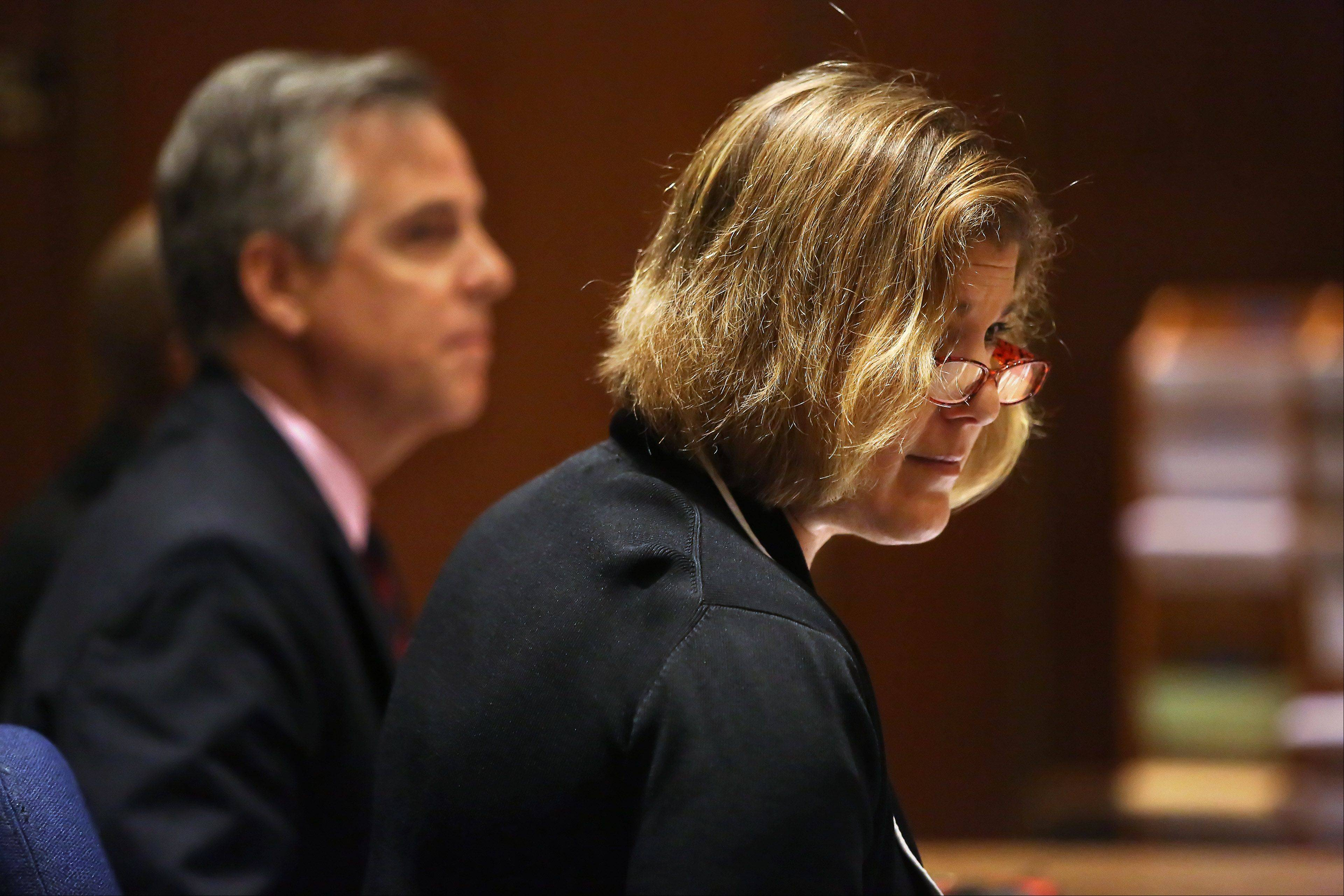 Randie Bruno, court-appointed public defender, and Keith Grant, chief of special defense for the Lake County public defender's office, listen to arguments during the murder trial of Montago Suggs of Kenosha, Wis., Tuesday at the Lake County courthouse in Waukegan. Suggs is accused of killing Melinda Morrell of Round Lake Park during a robbery at a check cashing store in Waukegan in 2007.
