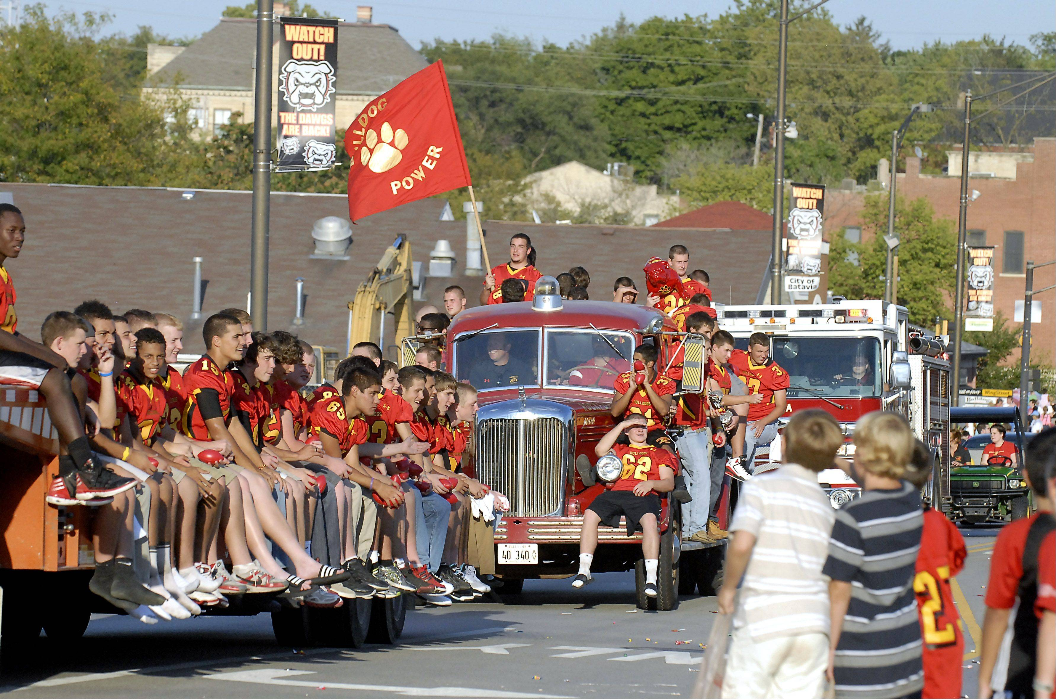 The Batavia High School varsity football team wraps up the school's homecoming parade last year on Wilson Street. This year's parade steps off at 5:30 p.m. Wednesday from the school.