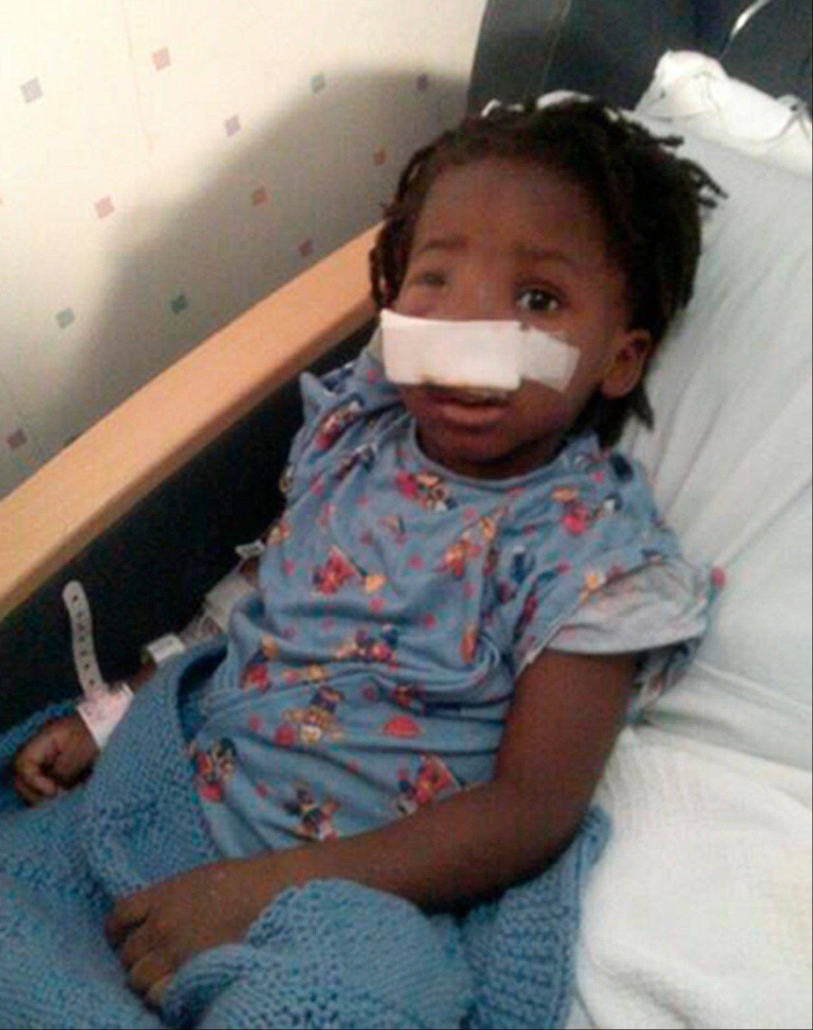 This family handout photo shows 3-year-old Deonta Howard recovering from a gunshot wound Monday at Mt. Sinai Hospital in Chicago. The boy was among 13 people shot Thursday night at Cornell Square Park on Chicago's Southwest Side.