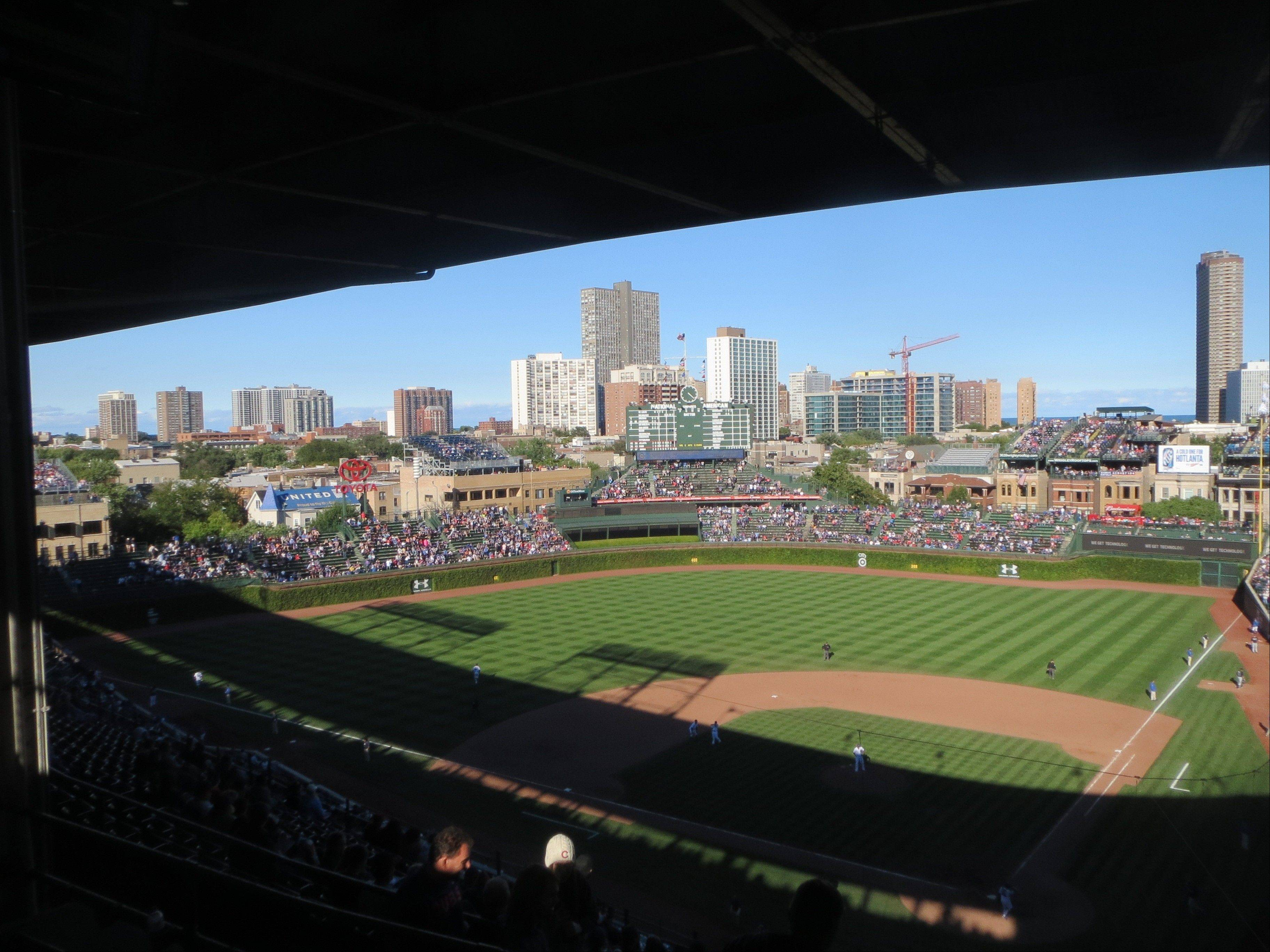 "The losing Cubs team on the field can be an eyesore, but I still love the view from our seats at Wrigley Field. I never hear myself saying, ""What this place needs is a giant, loud video screen to dwarf the old scoreboard."""