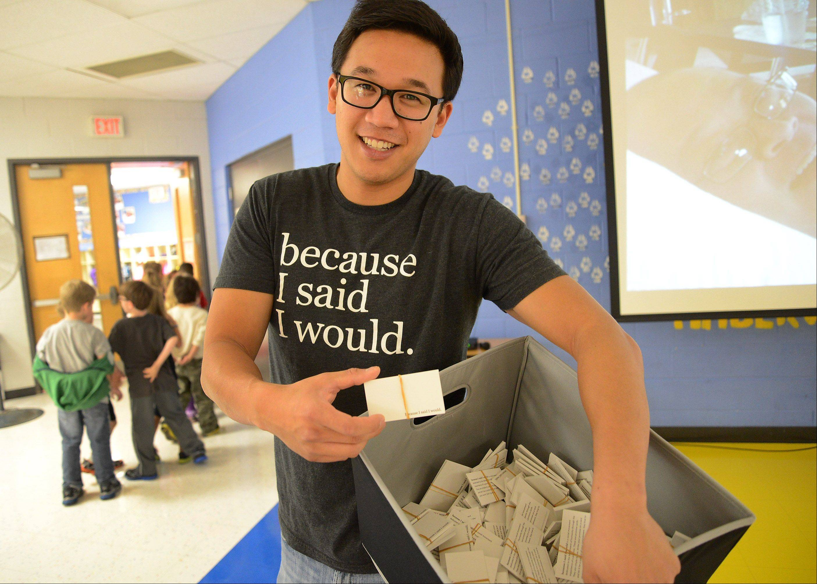 "Alex Sheen, founder of Because I Said I Would, speaks with Sycamore Trails students about the importance of making and keeping a promise. In his hands is a box of blank, white cards that read ""Because I Said I Would"" on the bottom. He encourages people to write their promises on the cards."