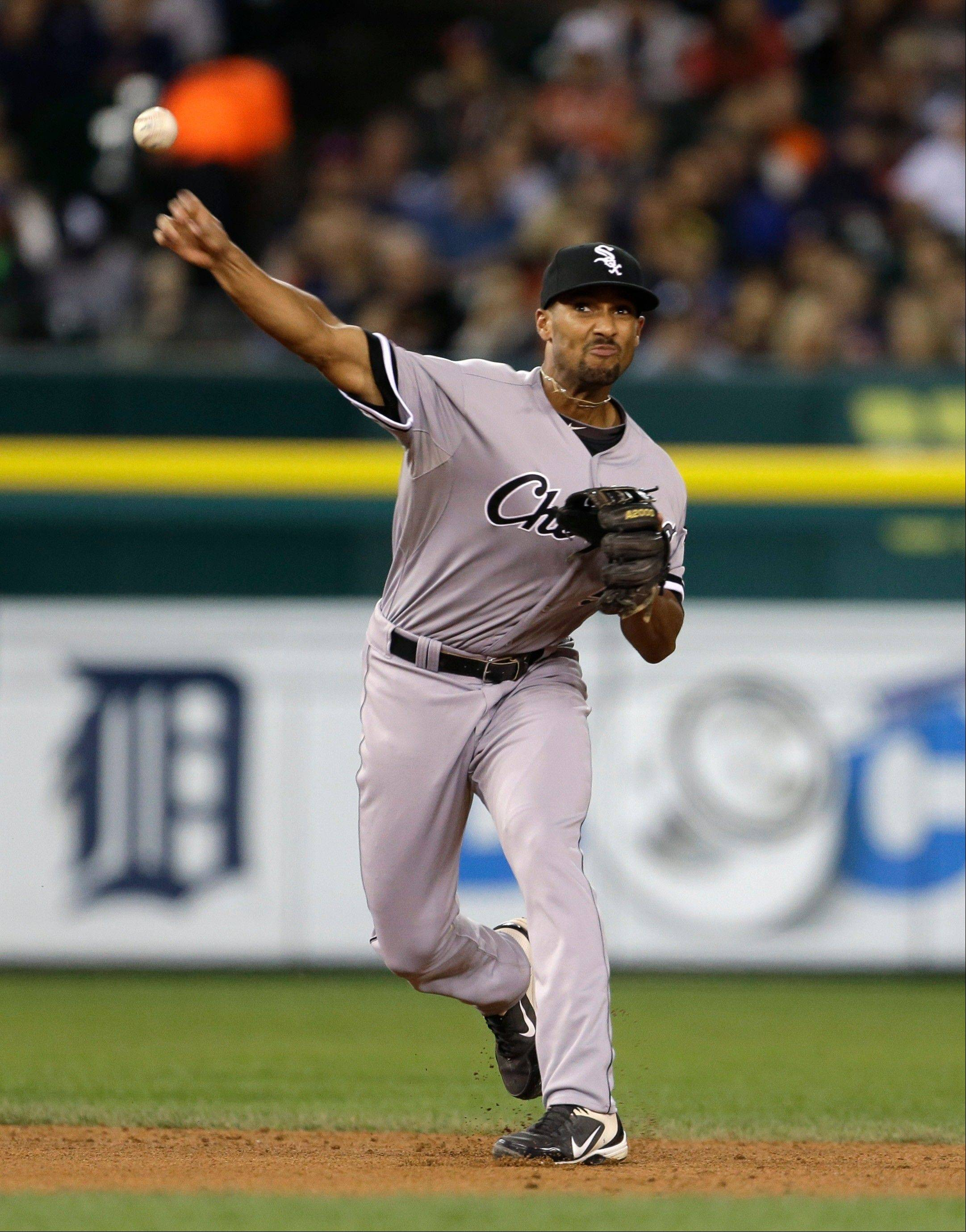 White Sox shortstop Marcus Semien throws out Detroit's Omar Infante during the fifth inning of Saturday's game.