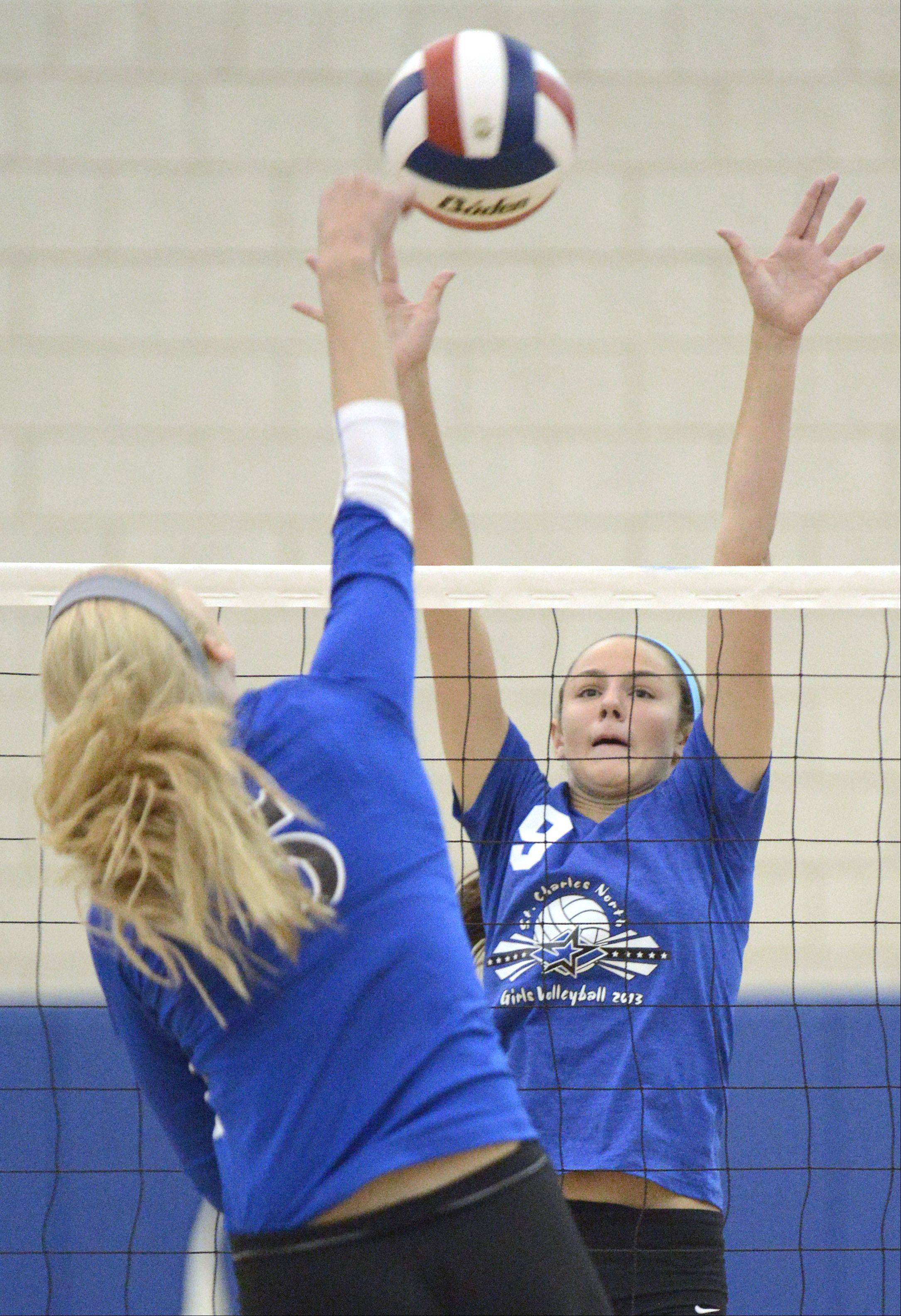 St. Charles North's Jaclyn Taylor attempts to block a spike by Geneva's Kyley Thompson in the second match on Tuesday, September 24.