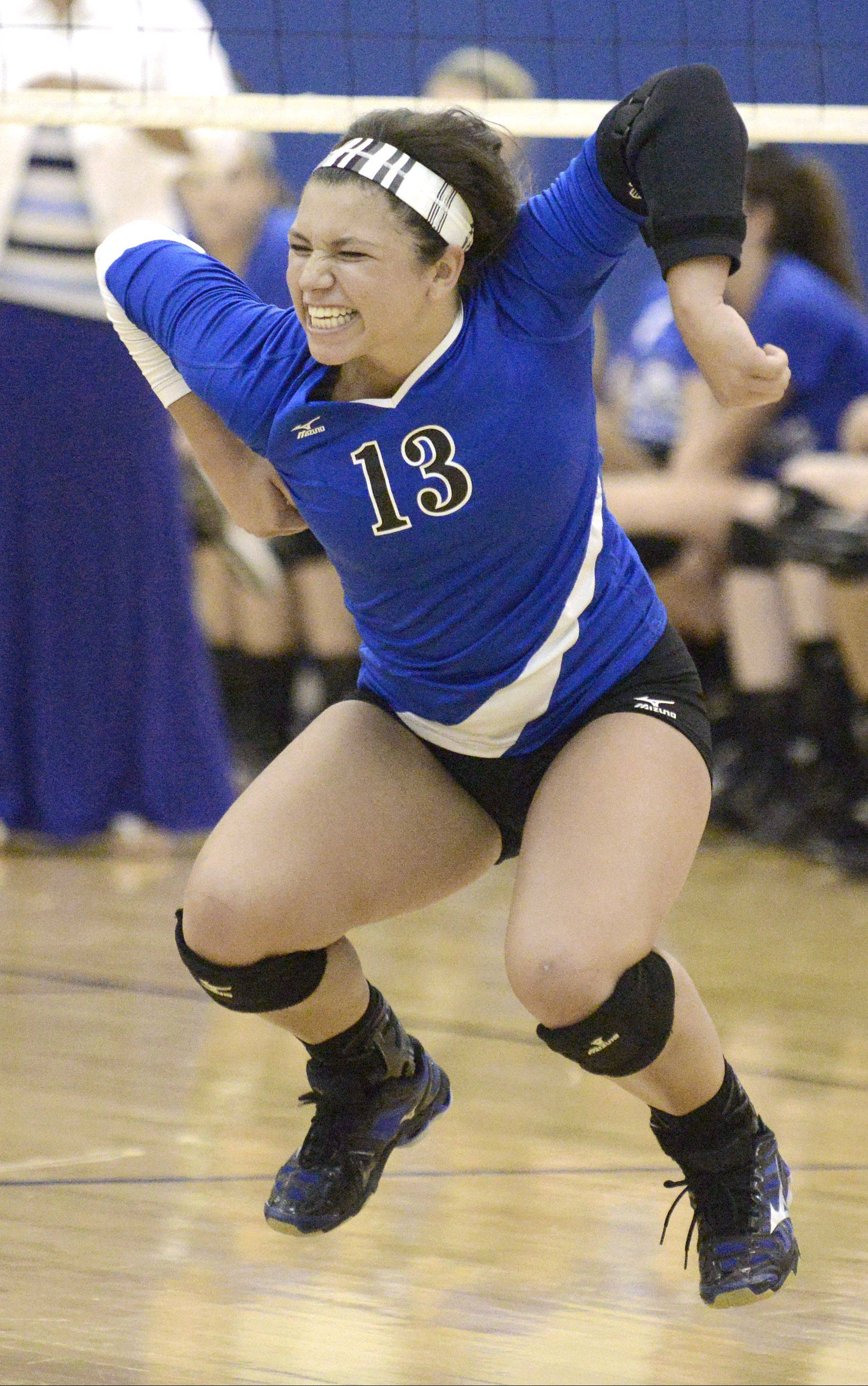 Geneva's Courtney Caruso celebrates a point as the Vikings close in on the win.