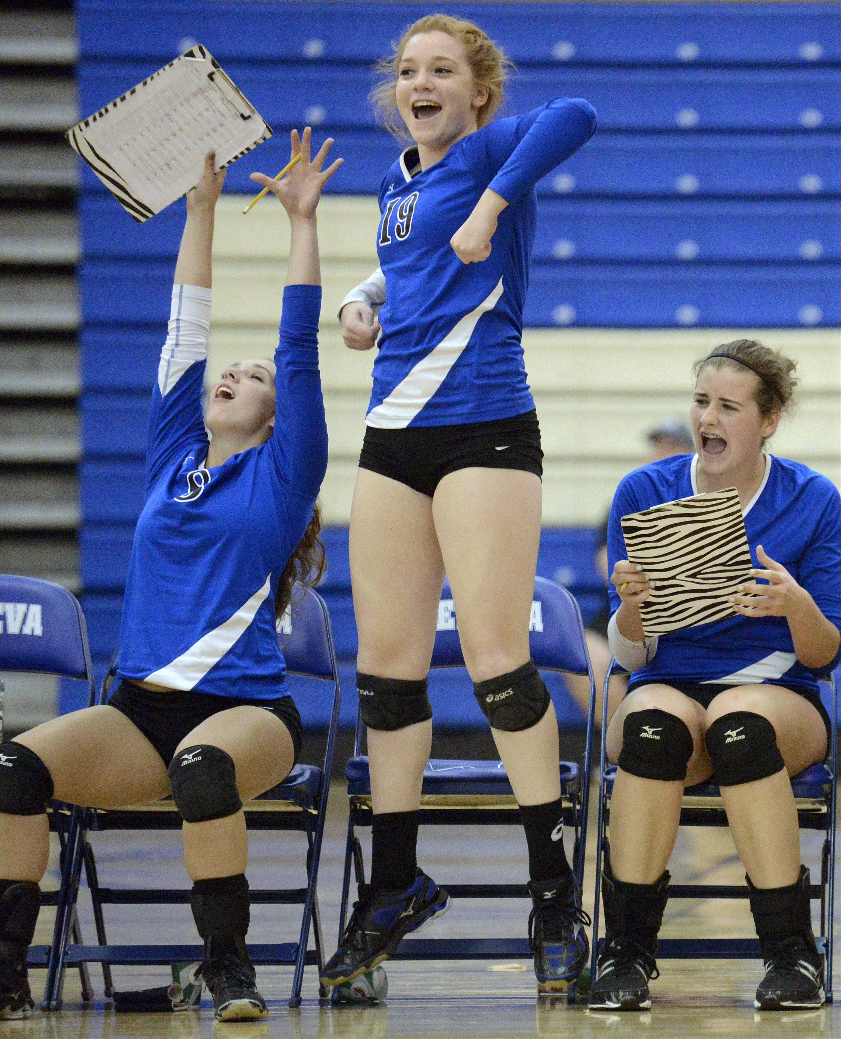 Left to right, Geneva's Hailee Hilmer, Camille Kolquist and Ally Barrett celebrate each point as they get closer to winning the nail-biter of a game in the final match vs. St. Charles North on Tuesday, September 24.